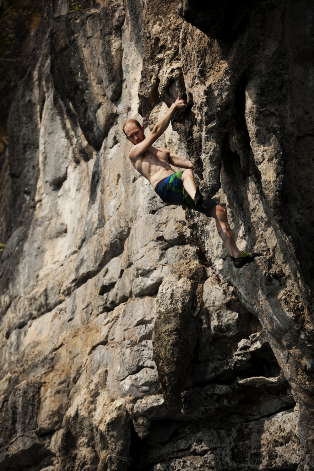 Aaron while deep water soloing in Thailand.