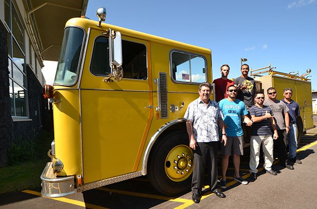Hawaiʻi CC fire science students and Fire Science Assistant Professor Jack Minassian, far left, and Diesel Mechanics Assistant Professor Mitchell Soares with the program's fire truck. Source: University of Hawaii.