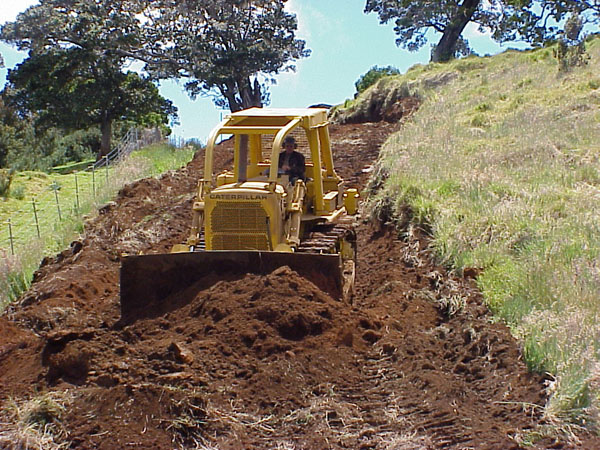 A Hakalau fuel break being established in 2006. The fuel reduction project aimed to establish a drivable and defensible fire perimeter around the refuge, according to the USFWS website. Photo: www.fws.gov.