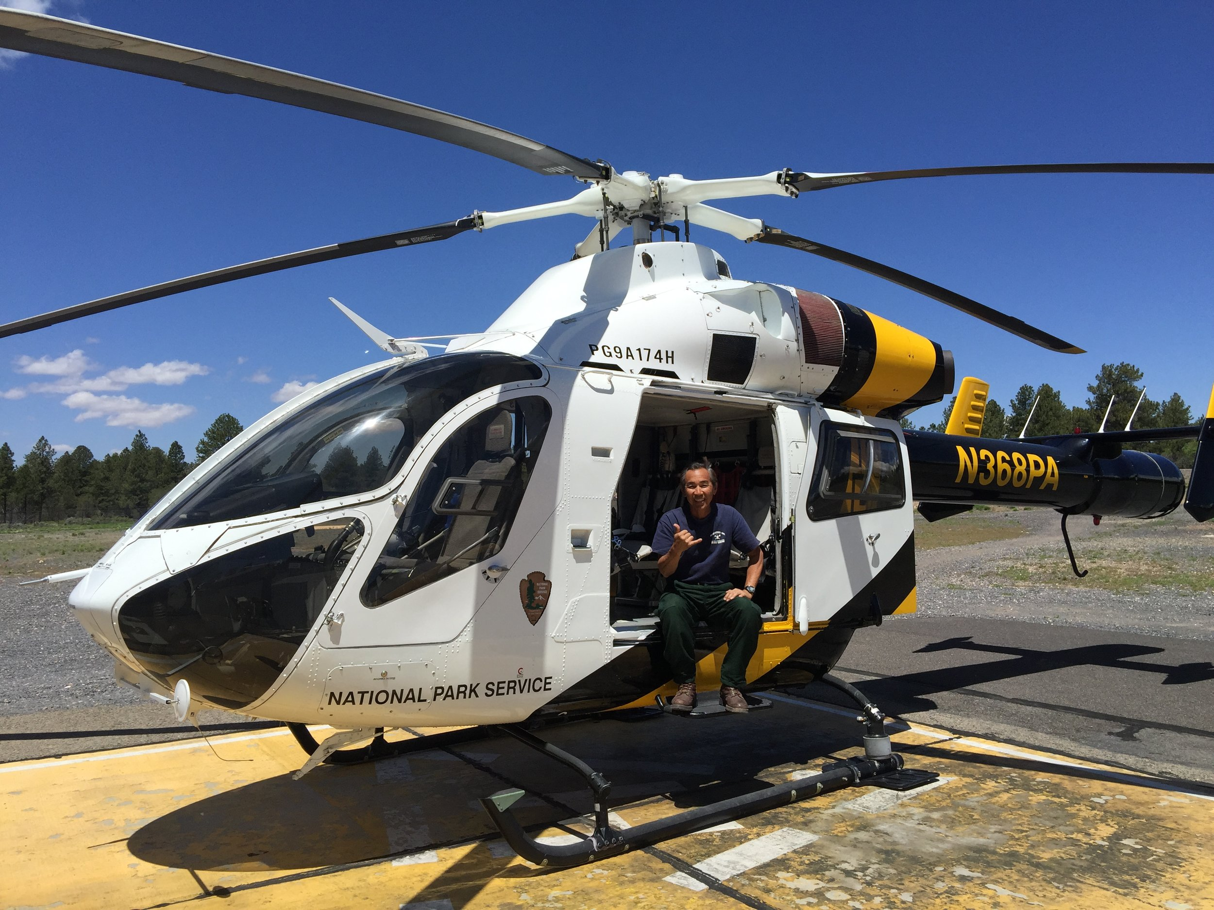 """Andy shakas from a helicopter. """"Working with the helitack crews is something I'll always remember."""" Photo: Andy Kikuta."""