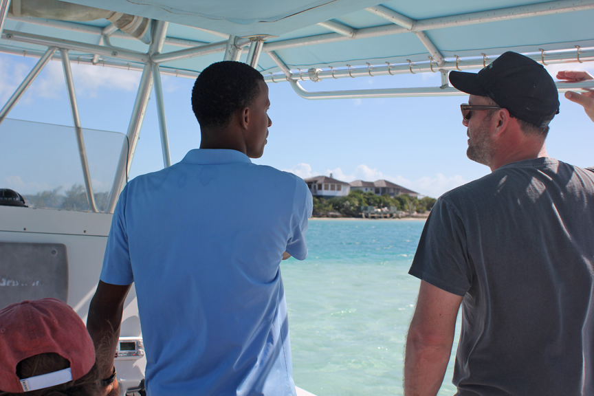 Getting the gossip on the fancy yachts in the harbor and the handful of private homes on Stocking Island (pop. 10).