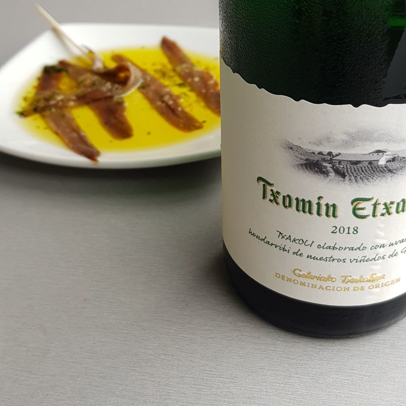 Txomin Etxaniz Txakoli with a little plate of Cantabrian Anchovies