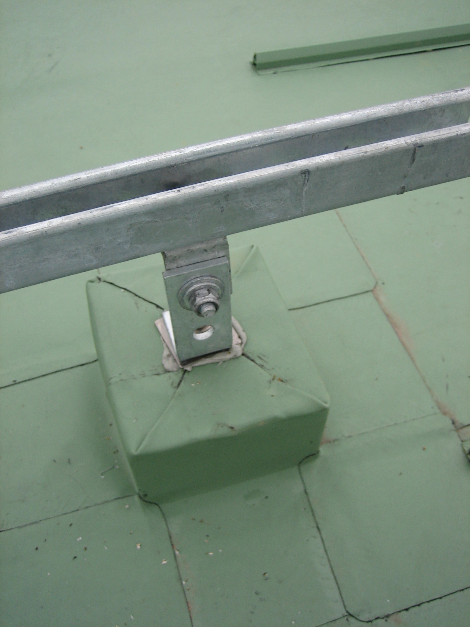 PV frame system flat roof fixing - singleply membrane roof.jpg