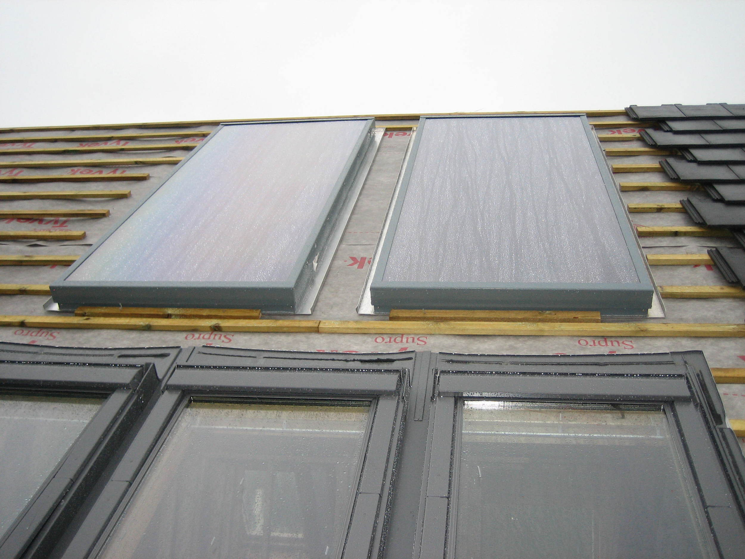 Solar air collectors mounted flush to battons.JPG