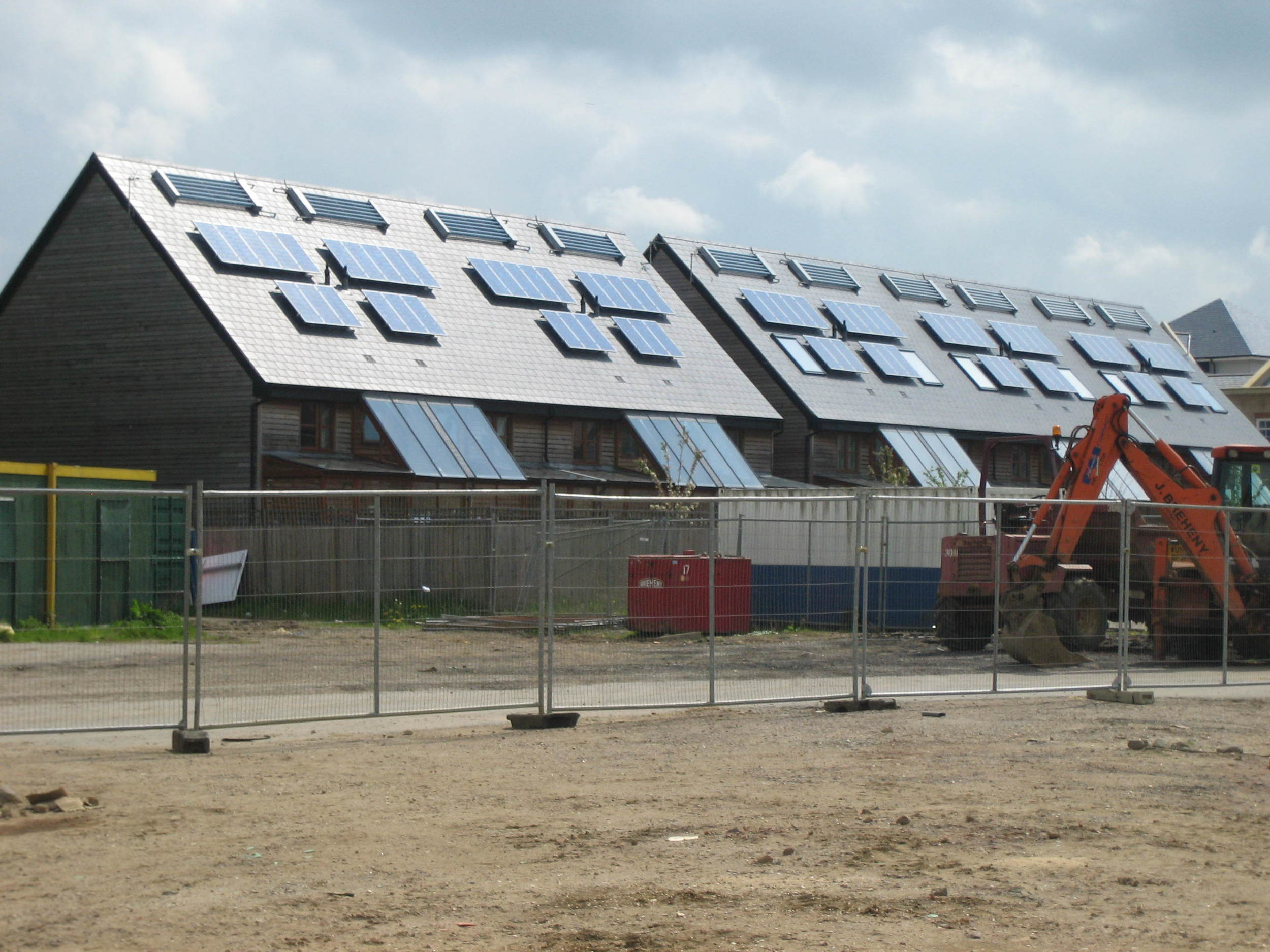 Solar evacuated tube and PV modules mounted above the roof plane - Cambourne.JPG