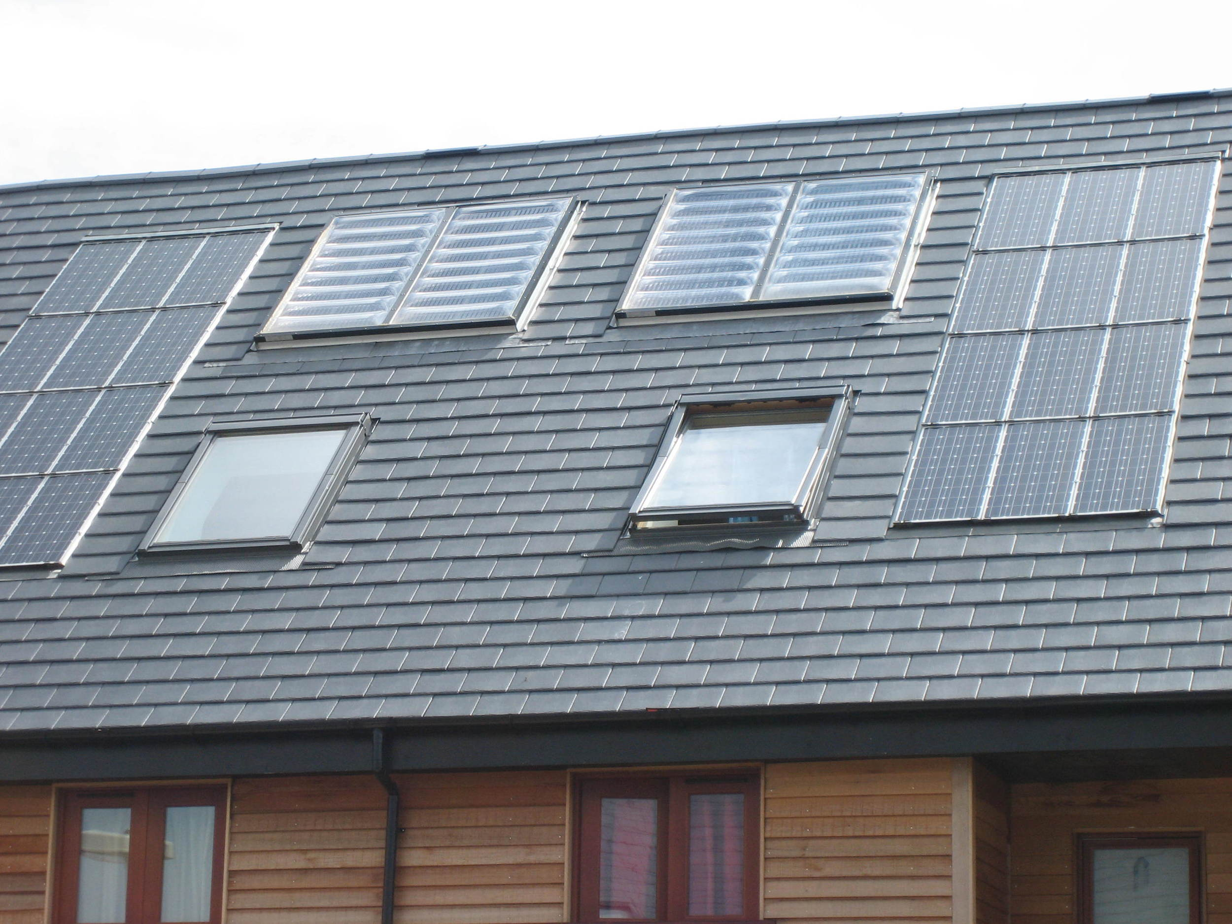 Solar water heating (flat plate collectors) and PV modules - Cambourne.JPG