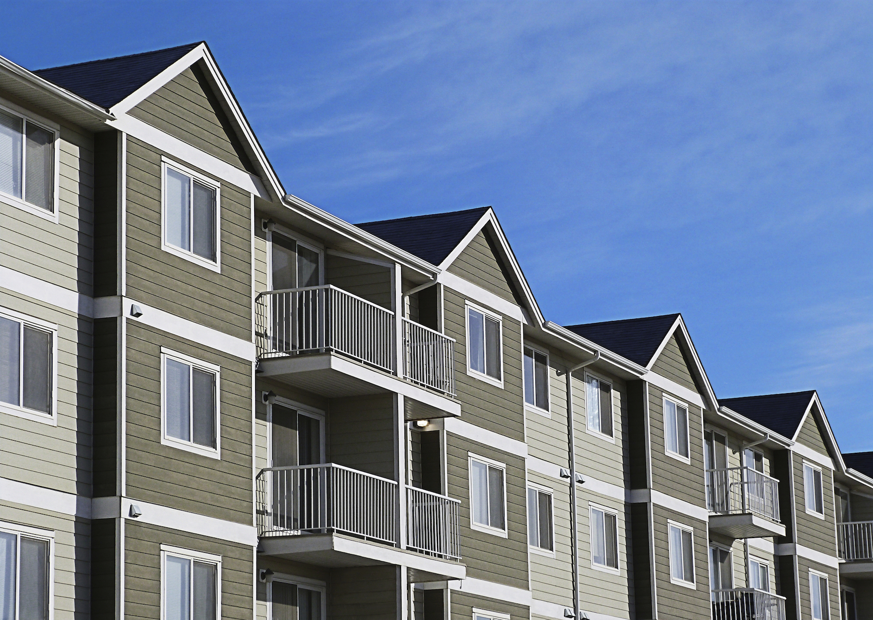 stock-photo-61945638-apartment-complex-with-blue-sky.jpg