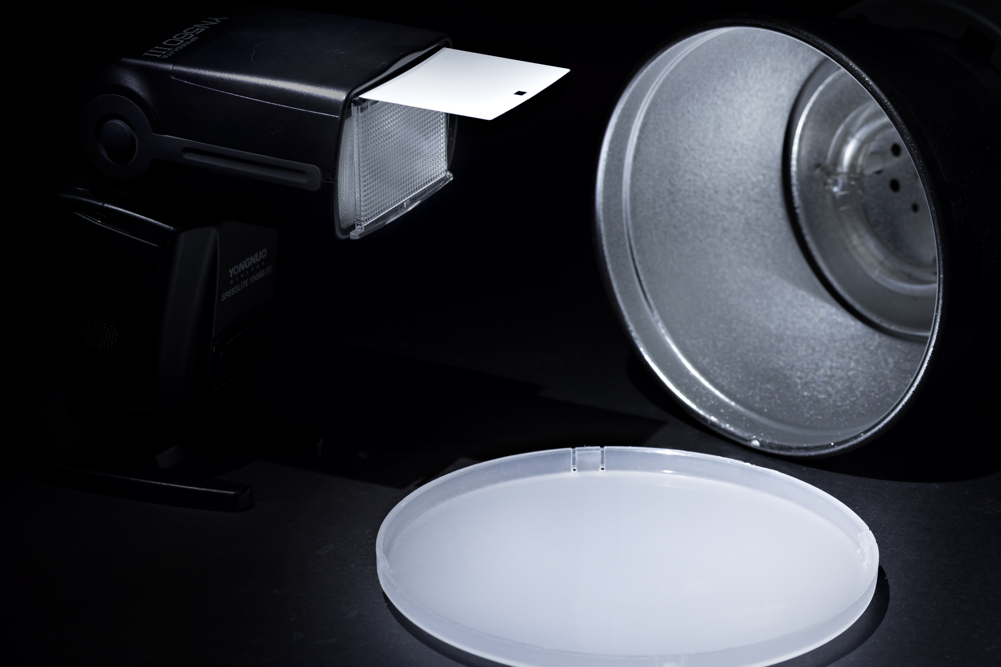 Diffusers can come with the flash as a snap-on accessory, or as a flip-out style that is present on most speedlights.