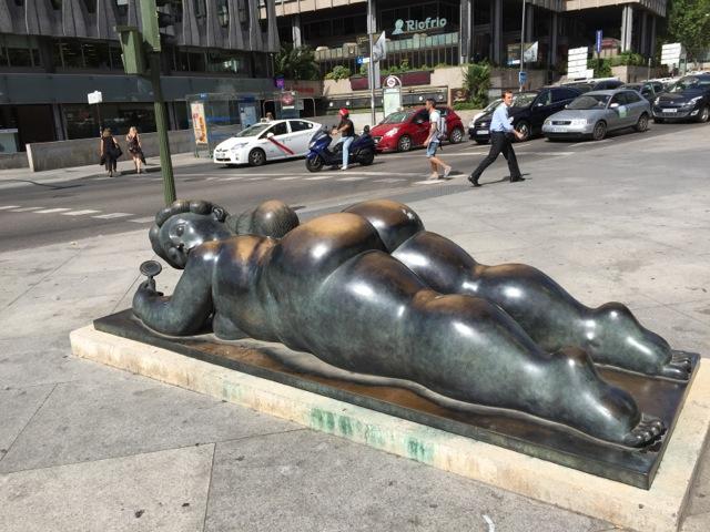 Bronze sculpture on sidewalk of Paseo del Prado, Madrid.