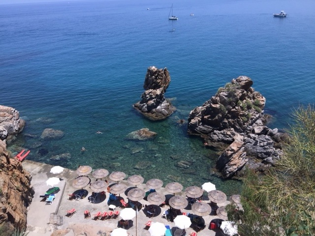 Beach below the Hotel Kalura in Cefalu, Italy. The warm, clear waters are a haven for tropical fish. (Photo by Suzan Friedland, 2015)