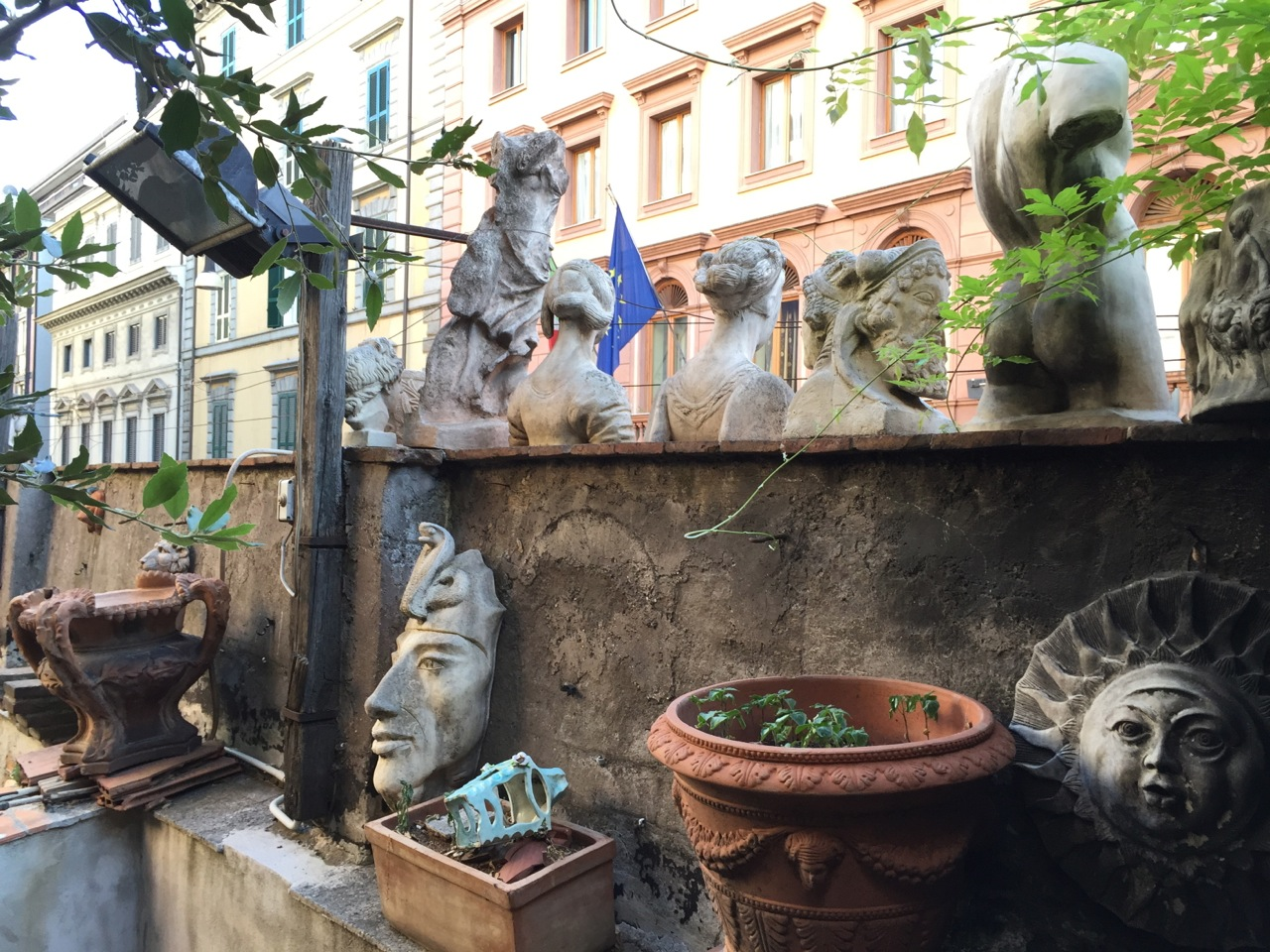 A cafe with a walled garden in Rome.