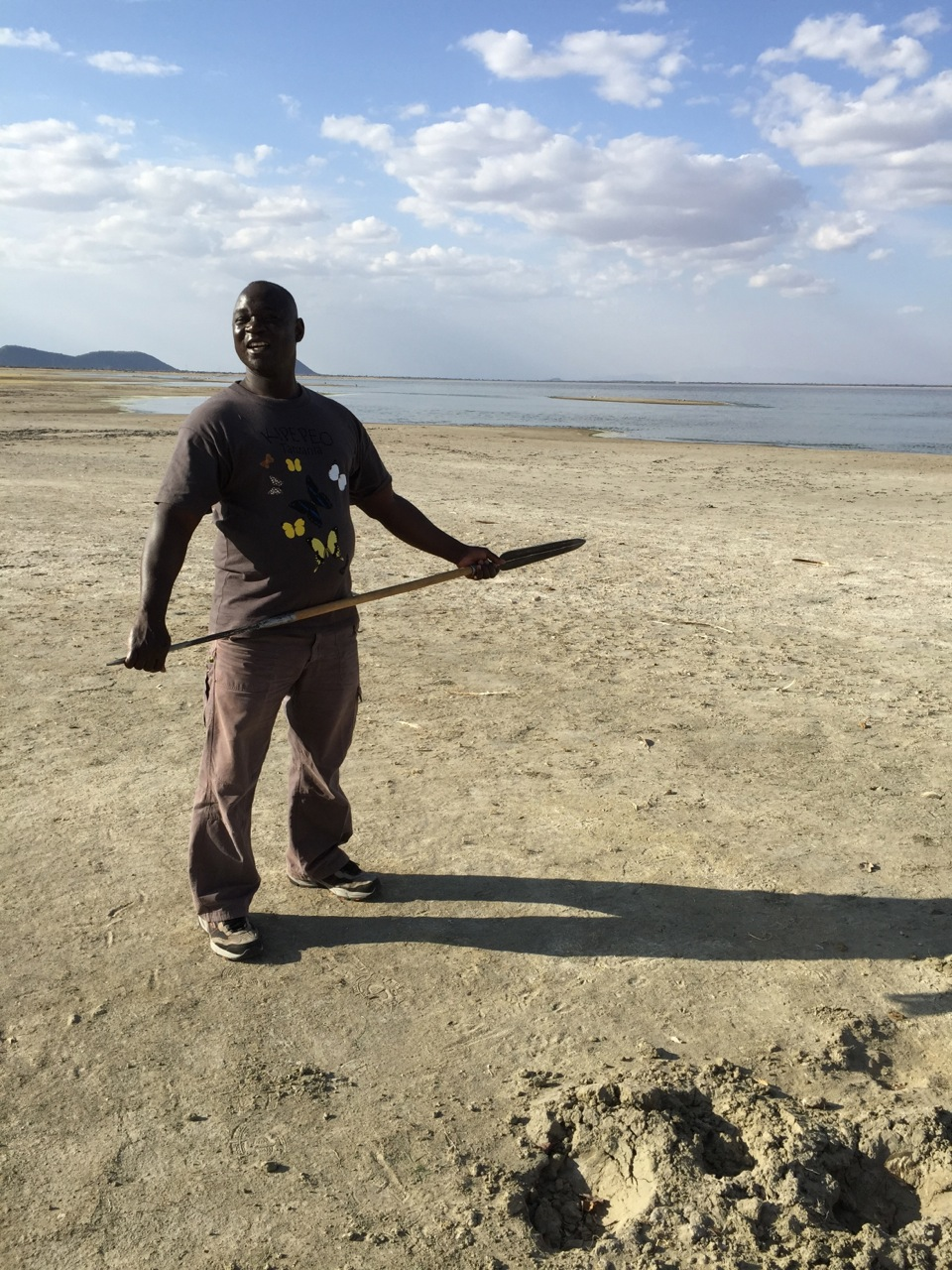 Our lead guide, Boniface Faustine, pointing out the footprints of a hippopotamus at Lake Burungi, Tanzania.