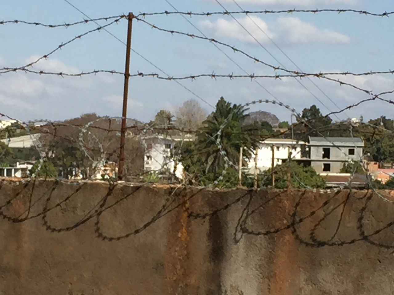 Razor wire topped every wall enclosing the compound that is named Hotel Paon d'or in Antananarivo.
