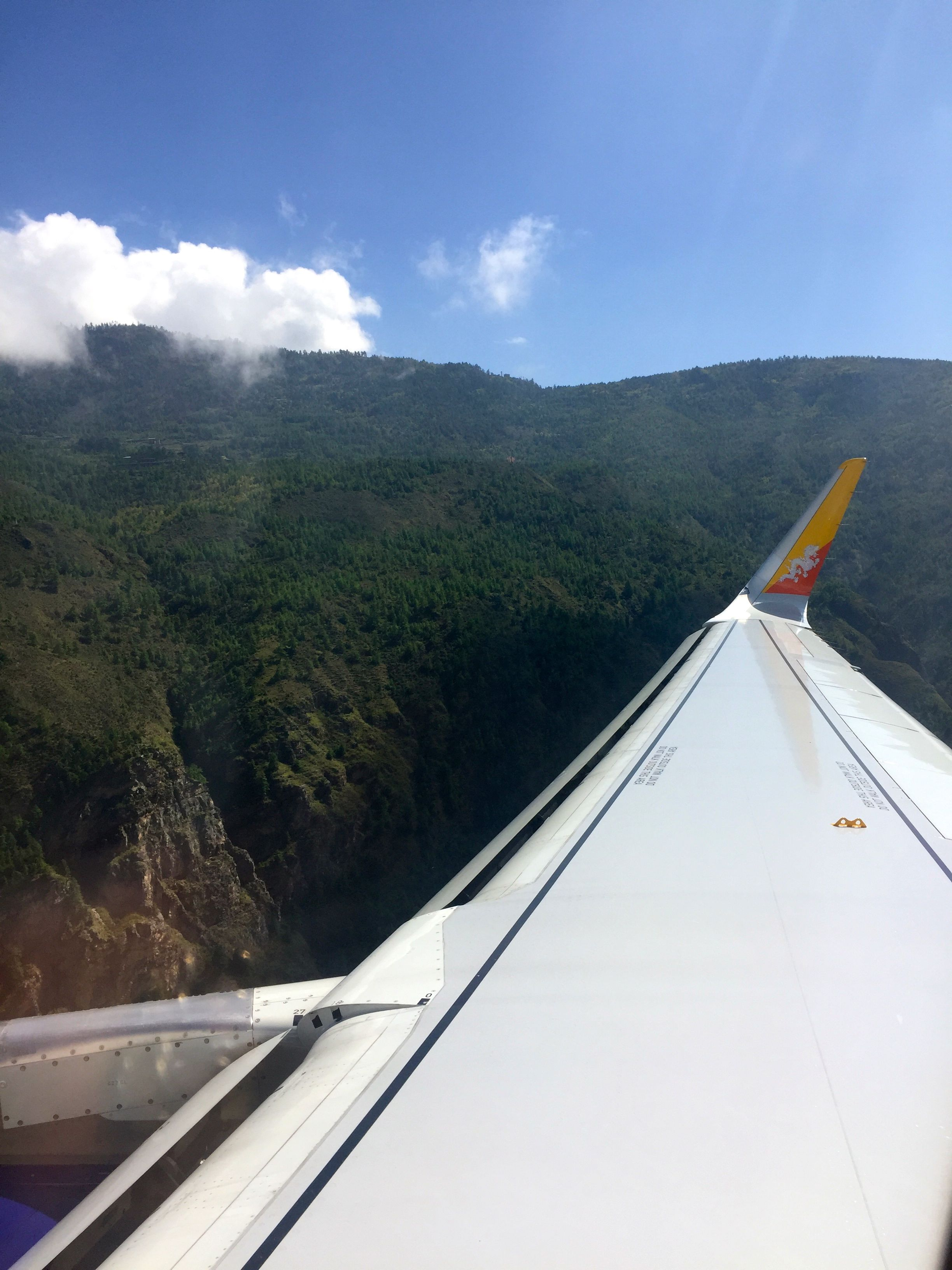 Beginning our descent into Paro International Airport, through the peaks of the Himalayas.