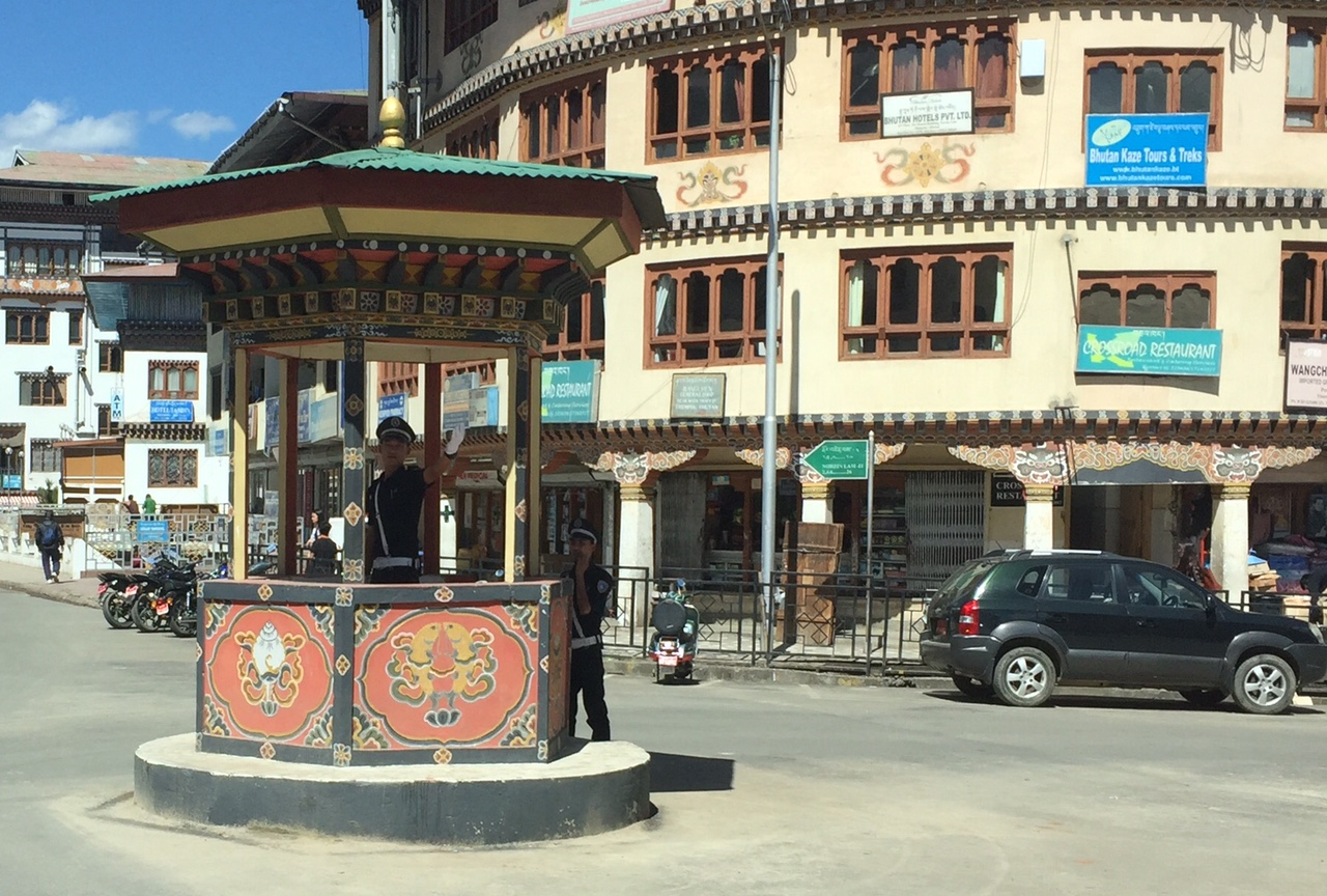 Police man directing traffic in major intersection in Thimphu, the capital of Bhutan.