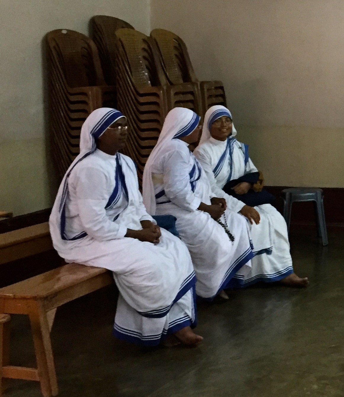 Sisters at the Order of the Missionaries of Charity, sitting near the tomb of Mother Teresa in Kolkata