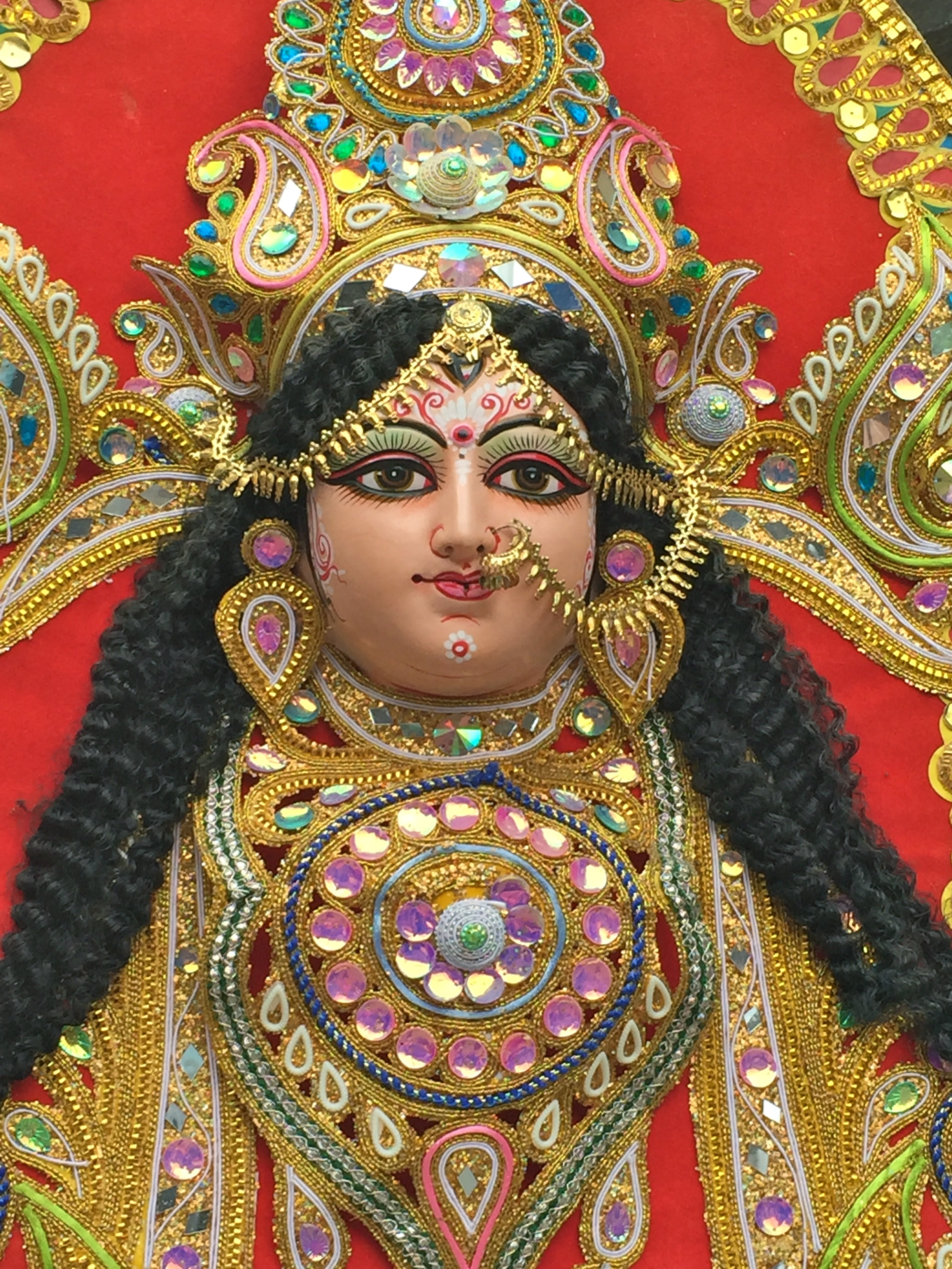 Statues and figurines are decked out in the most brilliant colors and jewels.