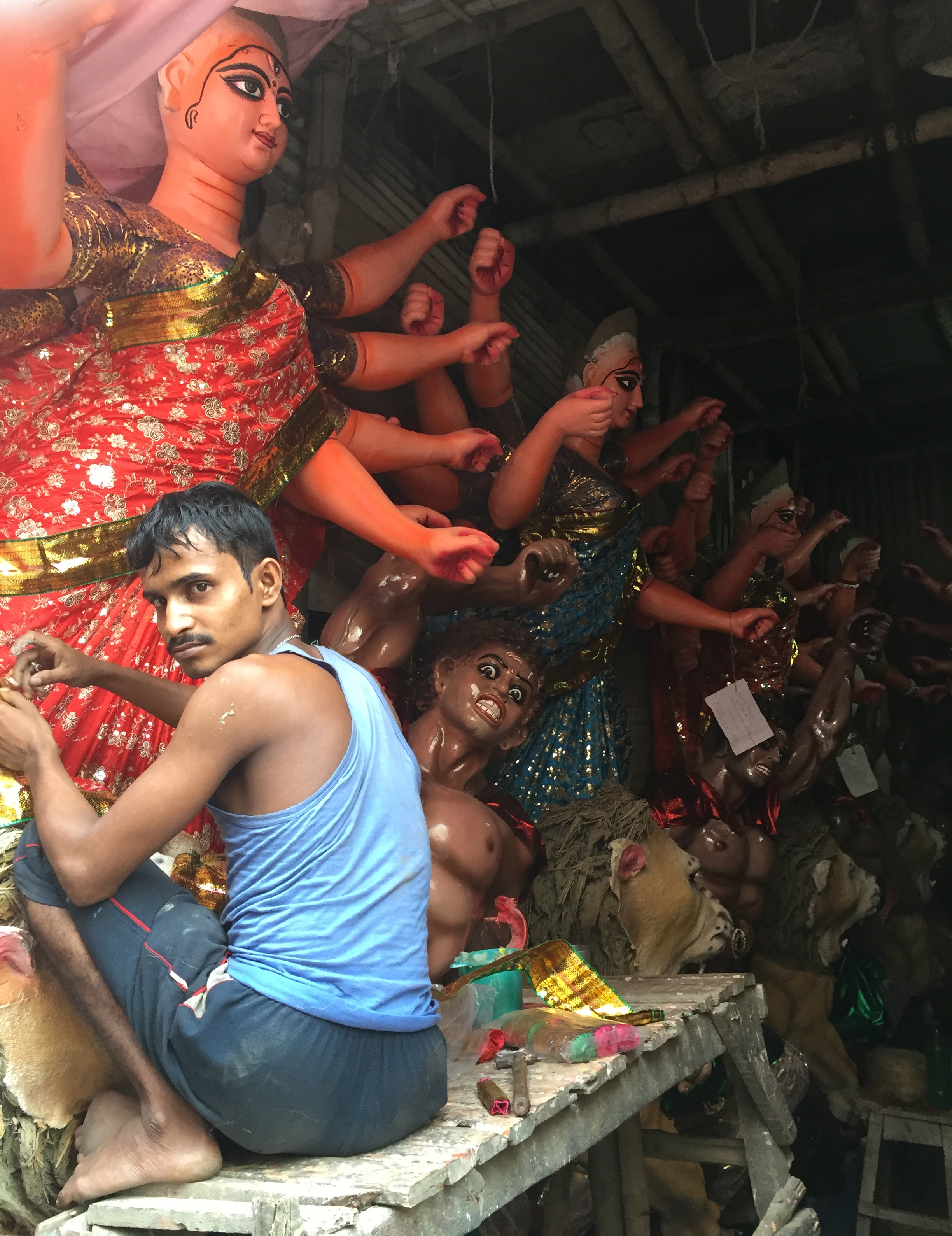 Artisan working on finishing statues for upcoming festival in Kolkata.