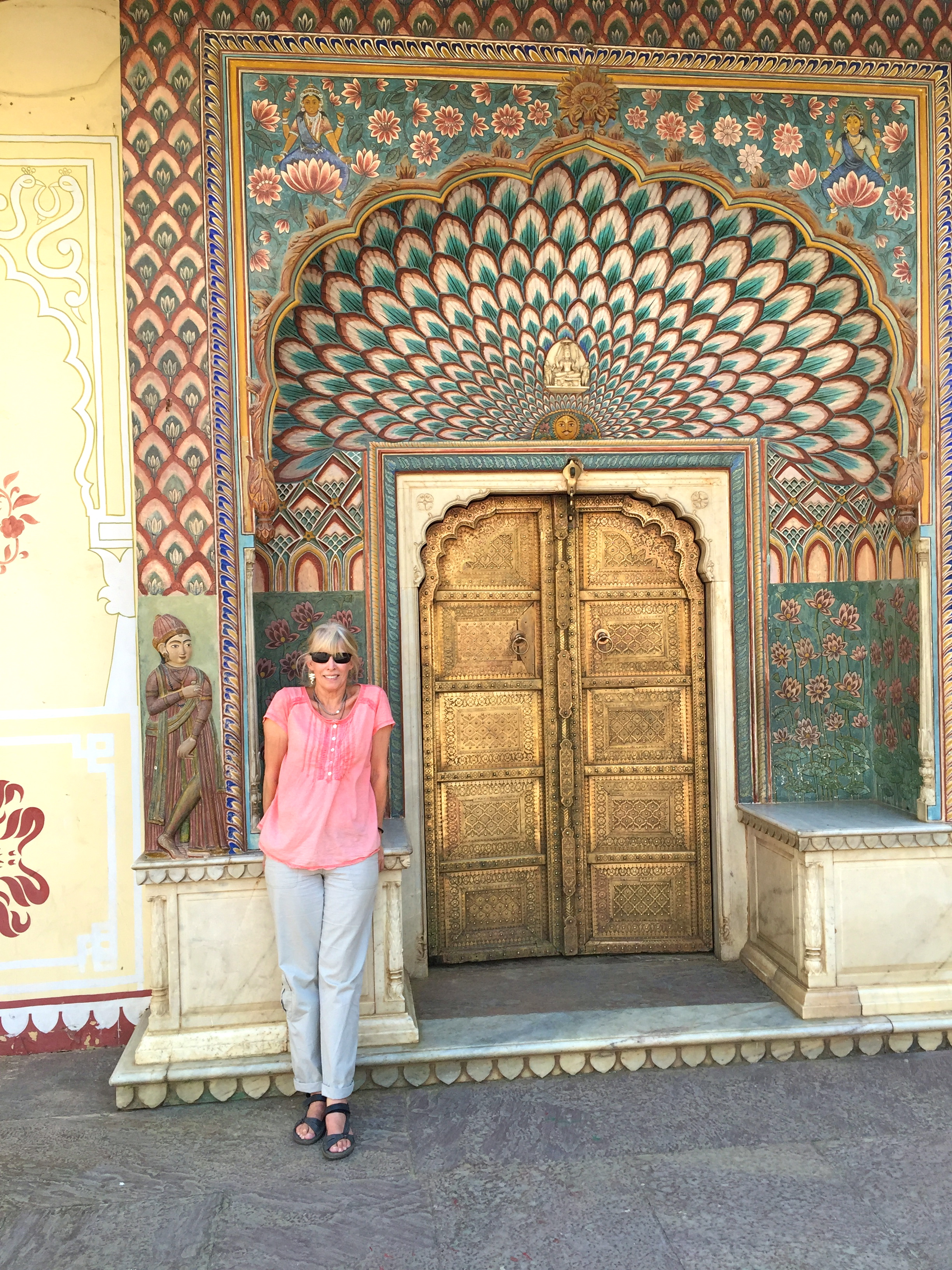 This is me standing in front of some doors from a courtyard at the City Palace of Jaipur.
