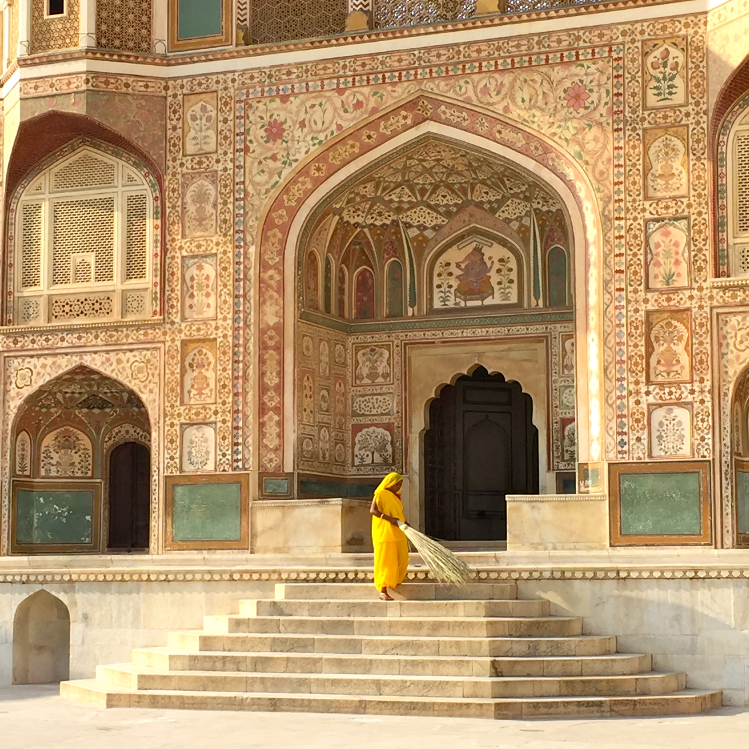 Woman sweeping the steps of the Amber Palace, Jaipur