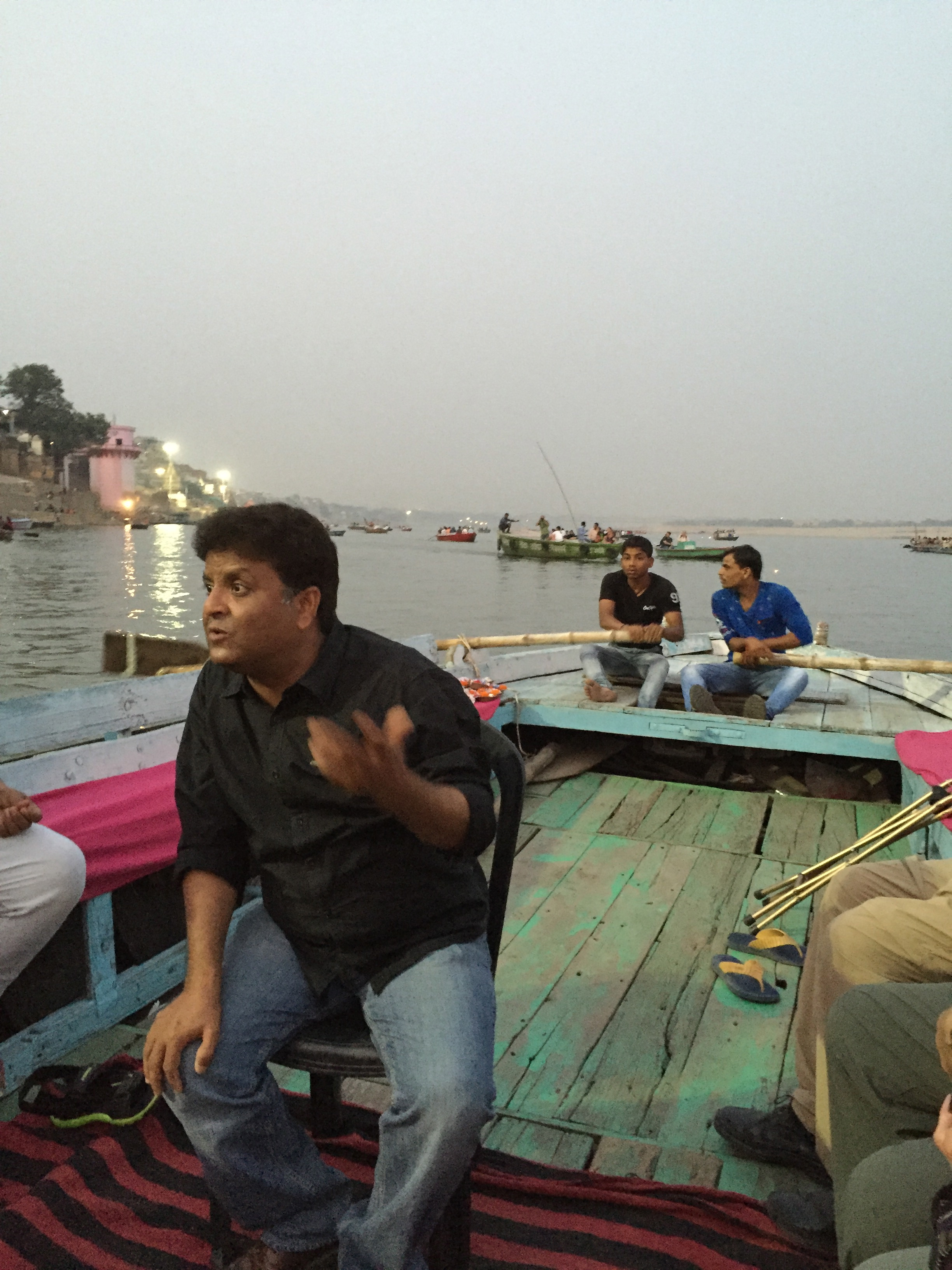 Aboard a small wooden boat, our guide explains the Hindu ritual cremations we are about to witness on the shores of the Ganges River in Varanasi, India.