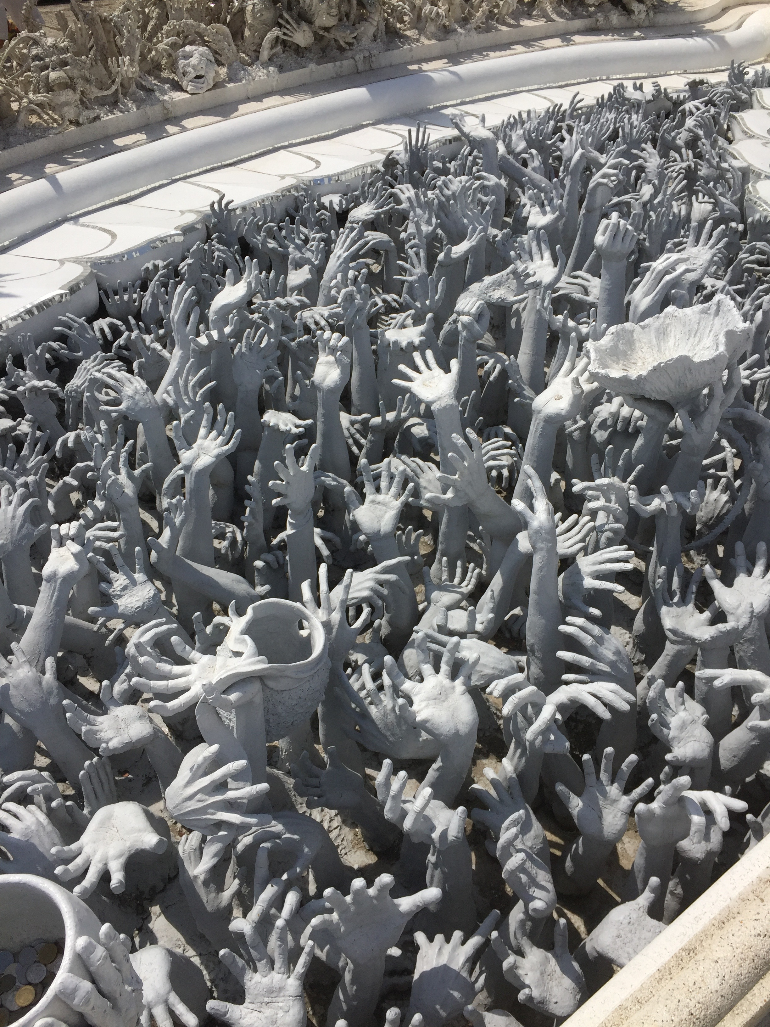 Parting shot of Thailand...a sculpture outside of the White Temple in Chang Rai, seeking donations to the venue.