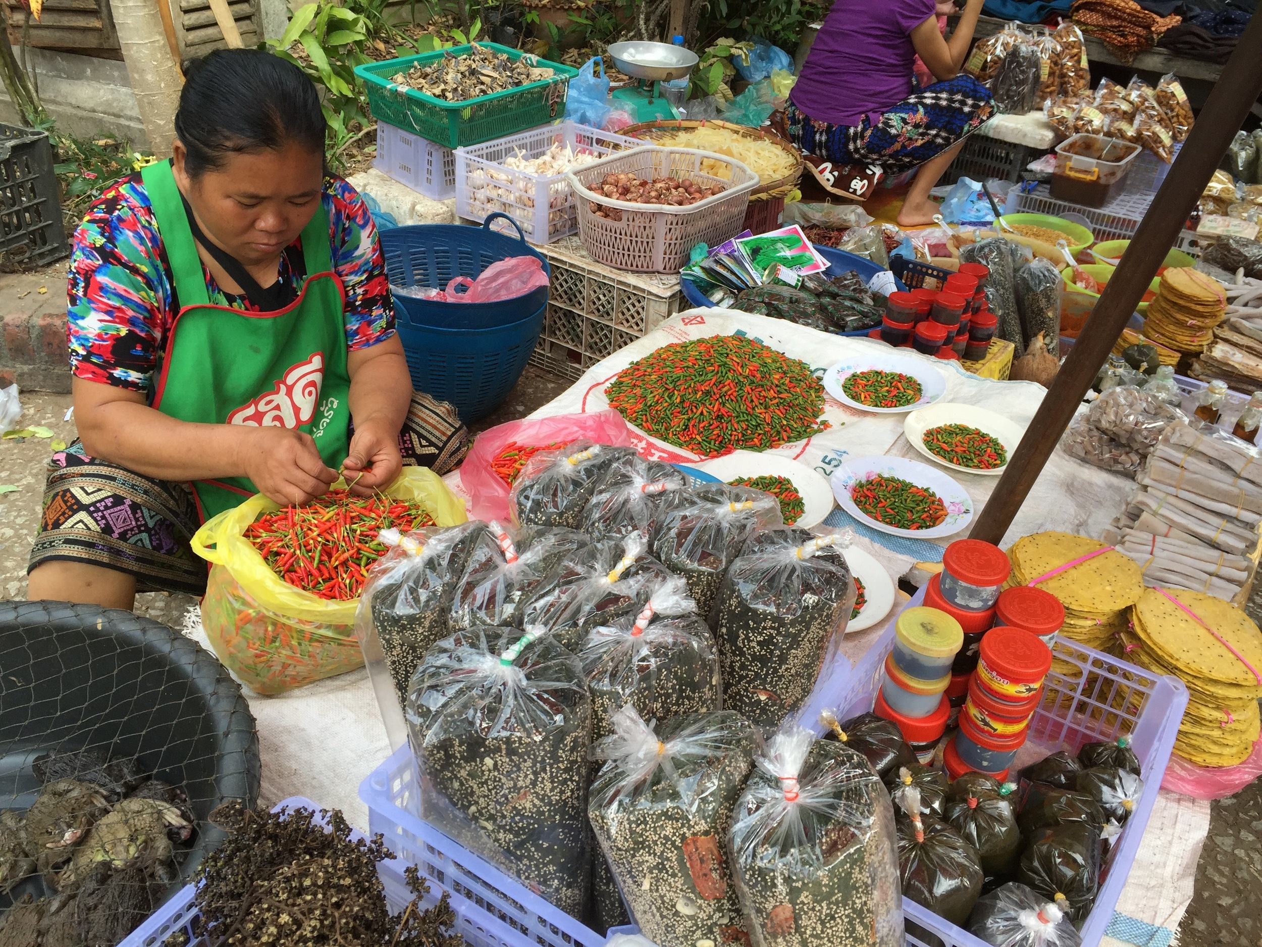 Colorful chilis and legumes are everywhere at the street market in Luang Prabang.