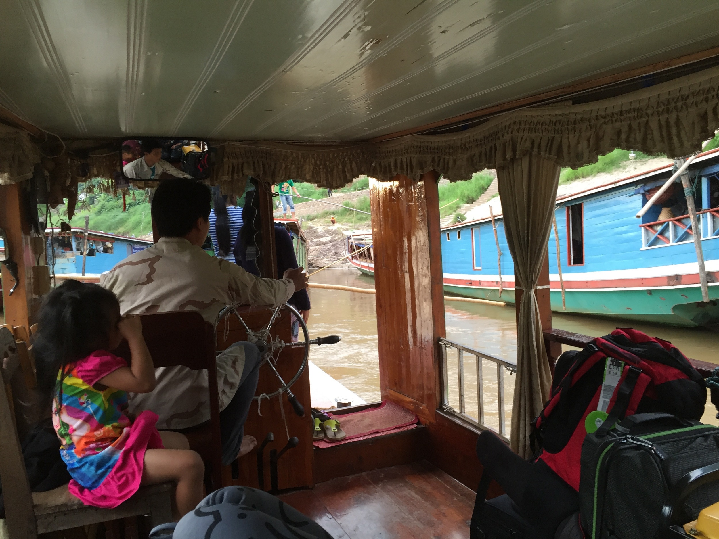Our tour group cruised the Mekong River for two days in this river boat owned and operated by a Lao family. These boats are a thriving part of the Lao tourist industry.