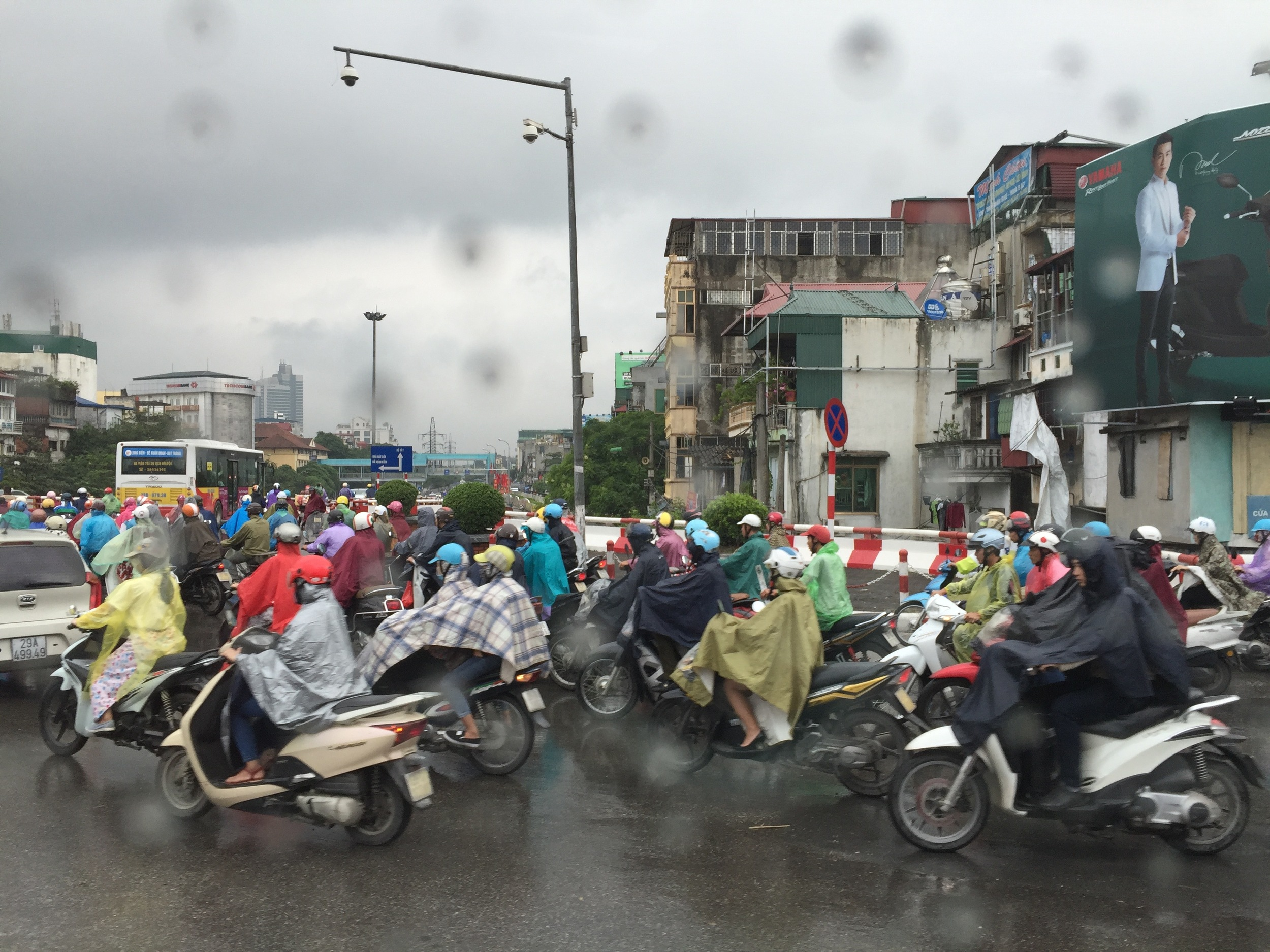 Everybody apparently rides a motorbike in the cities of Vietnam. Here in Hanoi, poncho-clad motorbikers barely seem to notice the downpour as they forge ahead.