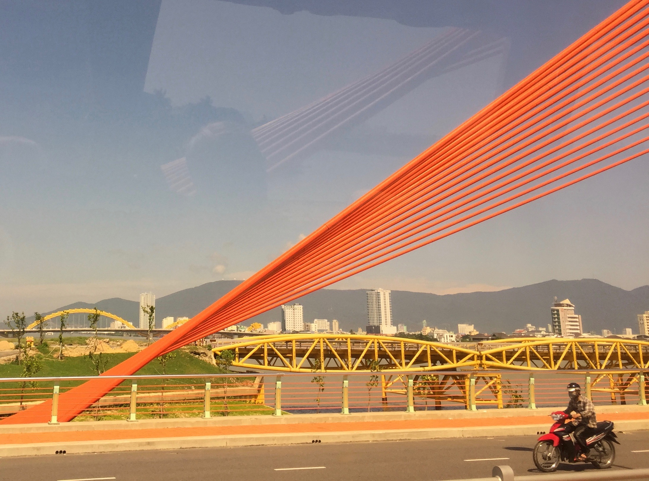 Crossing a bridge into Da Nang, now highly developed with beach resorts.
