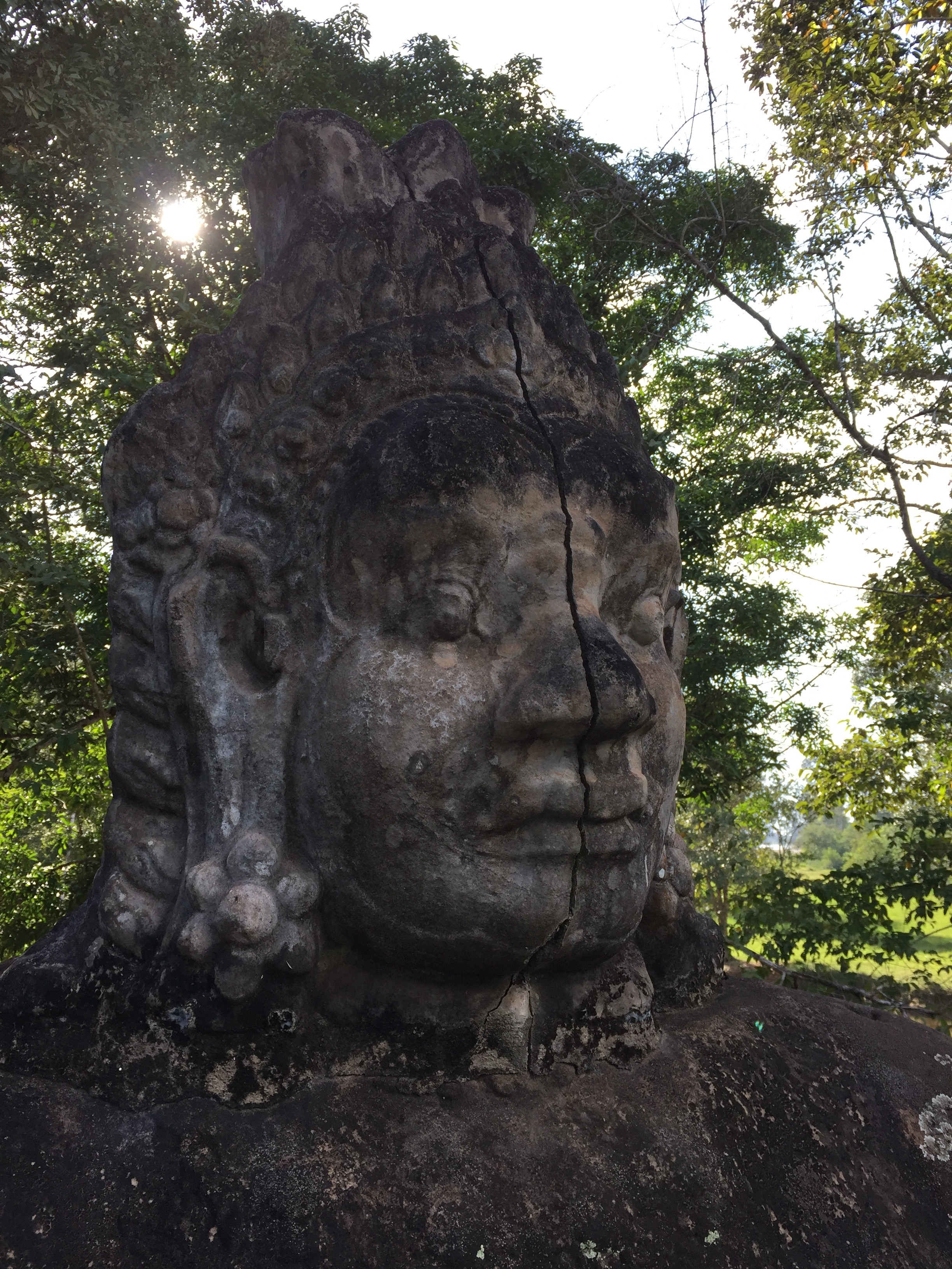 Huge stone head outside the entrance to Angkor Thom.