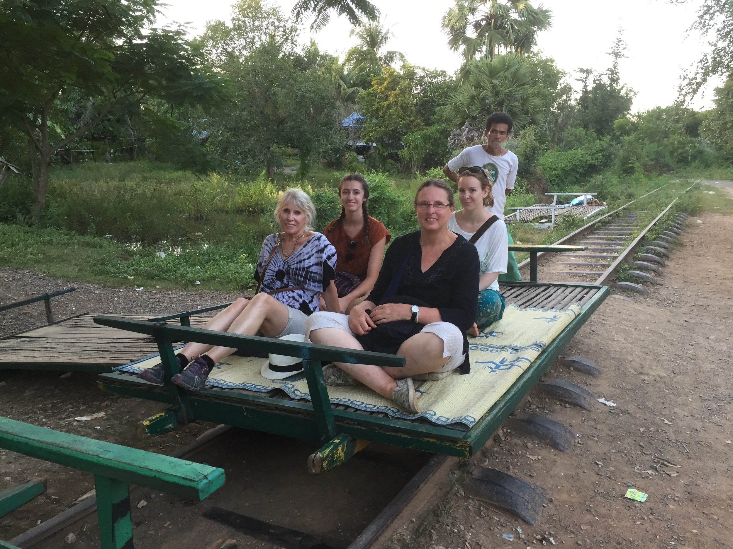 "That's me in the front on the left sitting with my Australian travel buddies on a ""Bamboo Train"" car. We had a wild ride!"