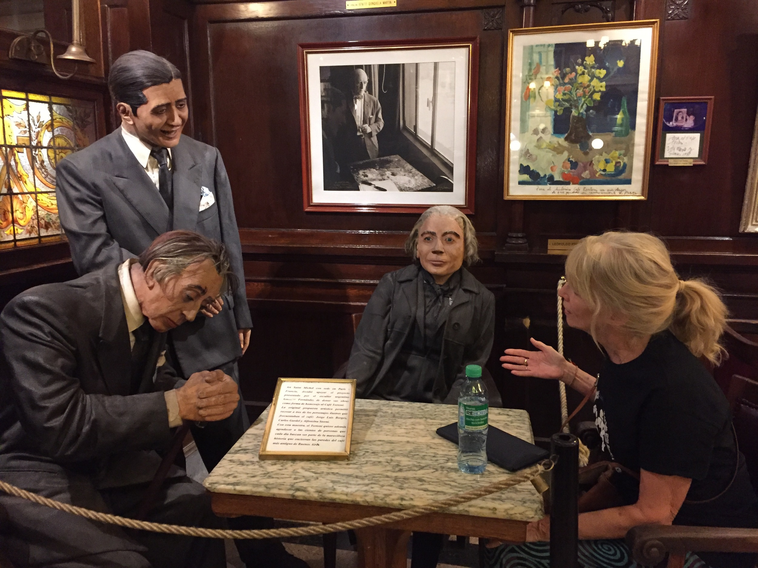 My fantasy conversation with  poet Jorge Luis Borges, tango legend Carlos Gardel and poet Alfonsina Storni  at the Gran Cafe Tortoni in Buenos Aires. (They are actually wax figures memorializing these great figures who used to hang out at the cafe.
