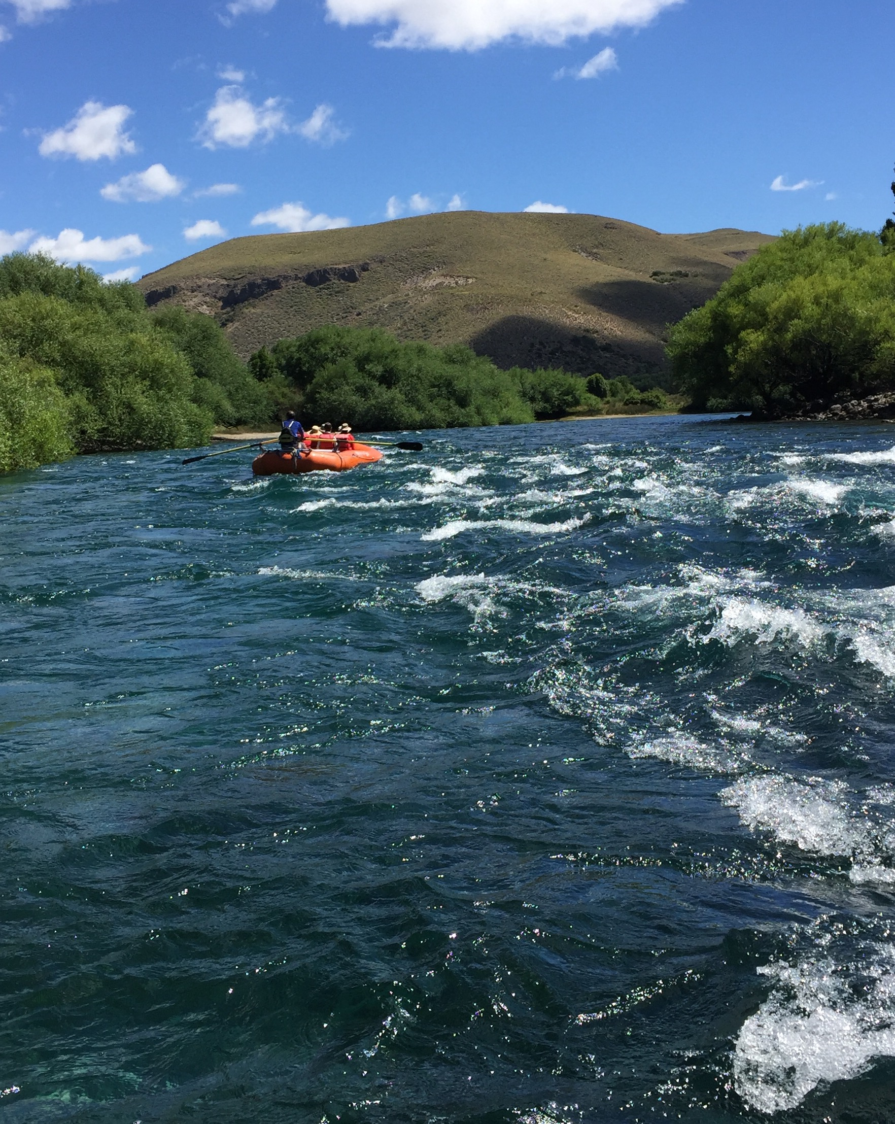 Enjoying a relatively calm raft trip down the beautifully clear Limay River.