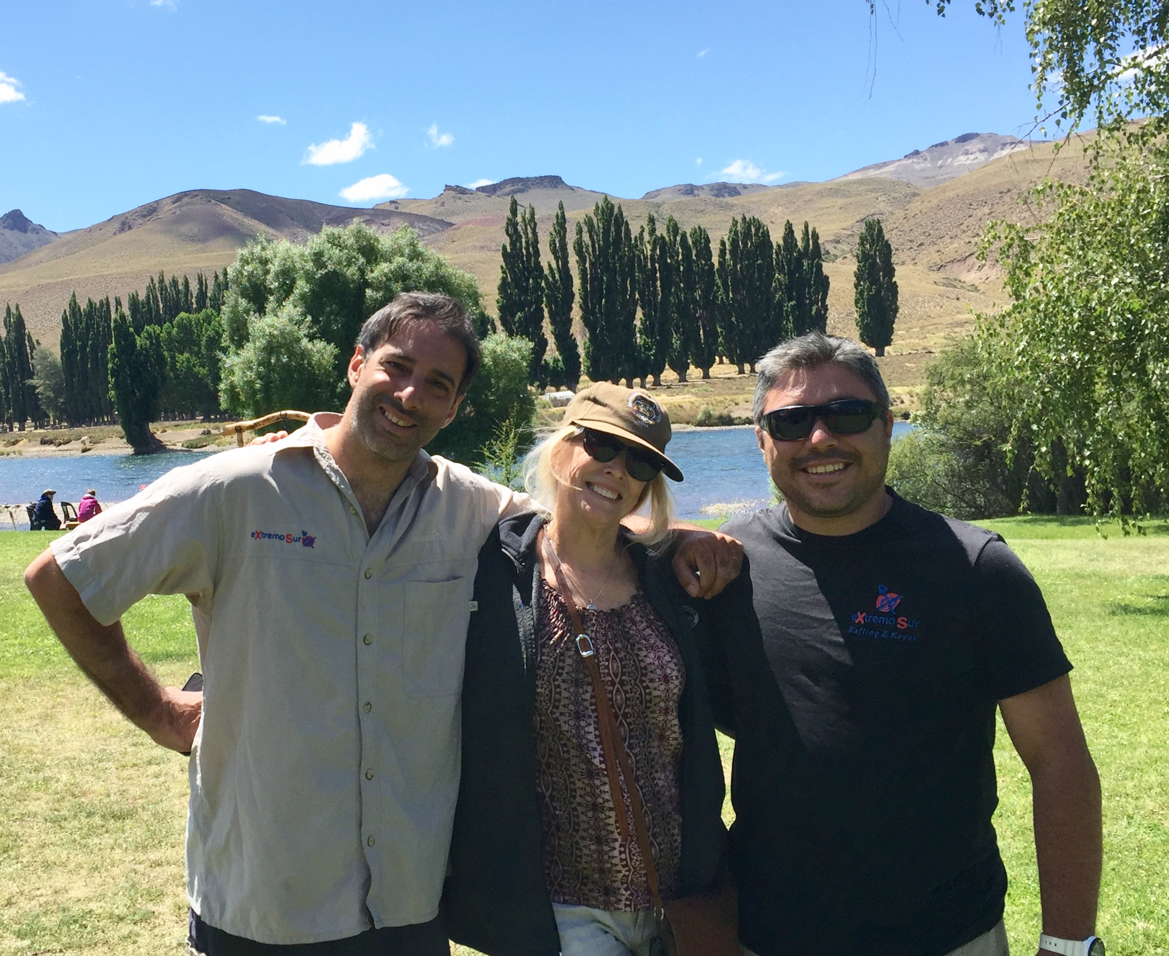 This is me enjoying the company of our two river guides after we landed alongside the Limay River. Behind us you can see some poplar trees, which are not native to Chile, but were planted by ranchers to supply much-needed shade.