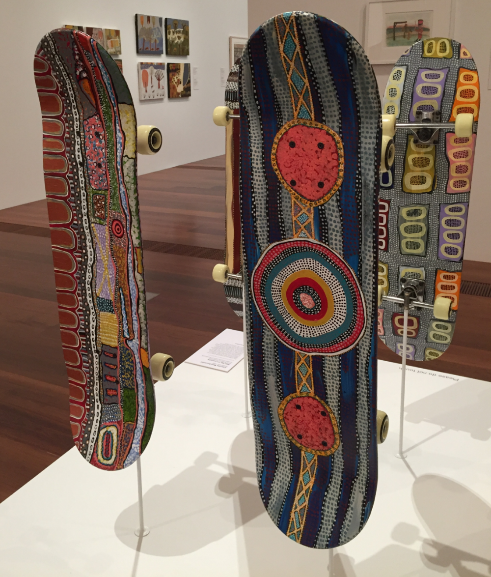 """360 degree spin on Country,"" skateboards painted by Claudia Moodoonuthi, on display at the National Gallery in Melbourne, Australia"