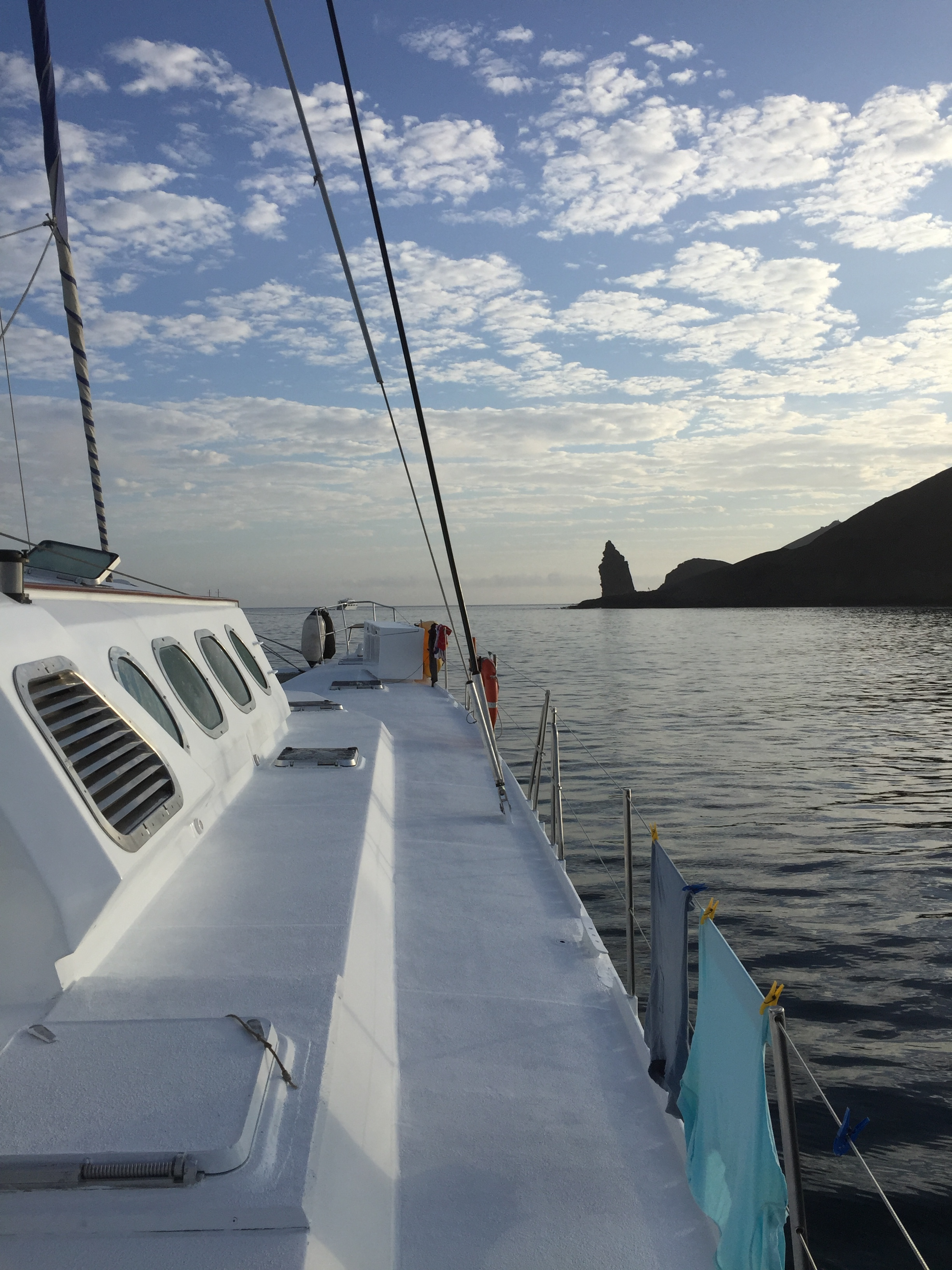 Approaching an eroded volcanic rock on the coast of Santiago Island.