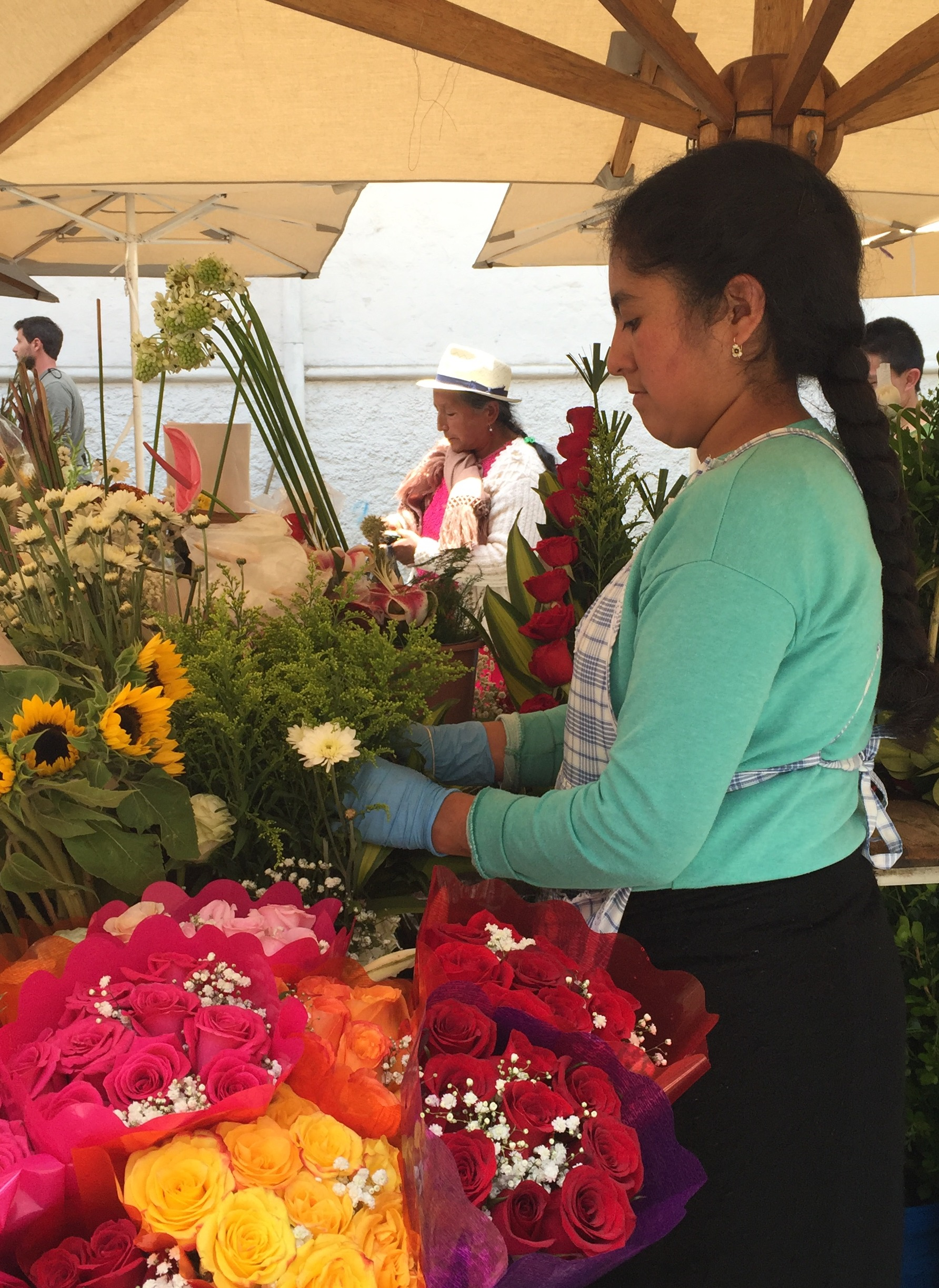 A flower vendor at work in Cuenca's flower market.