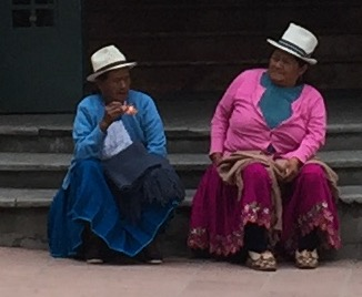 Two local women wearing their ever-popular Panama hats, which are actually made in Cuenca, Ecuador!