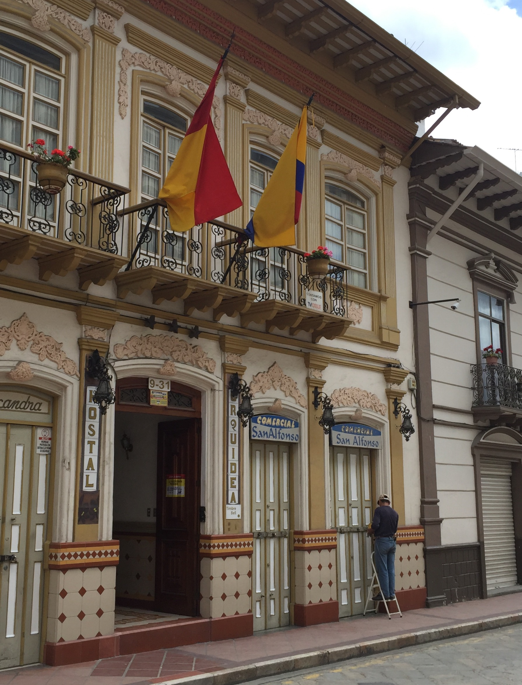 Typical architecture complete with tile front and wrote iron balcony in Cuenca, Ecuador.