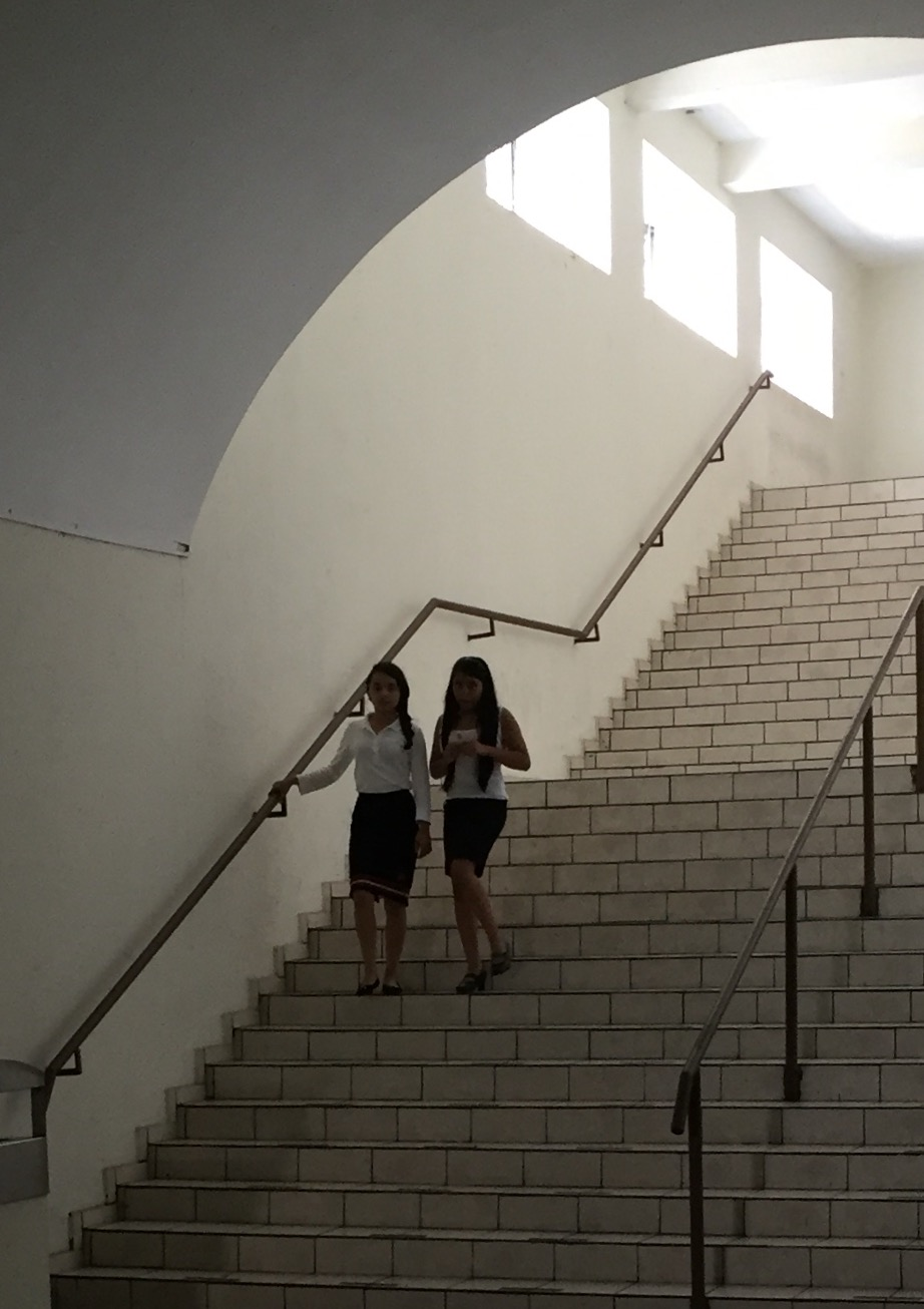 Two Salvadoran girls descending the staircase of San Salvador Cathedral.