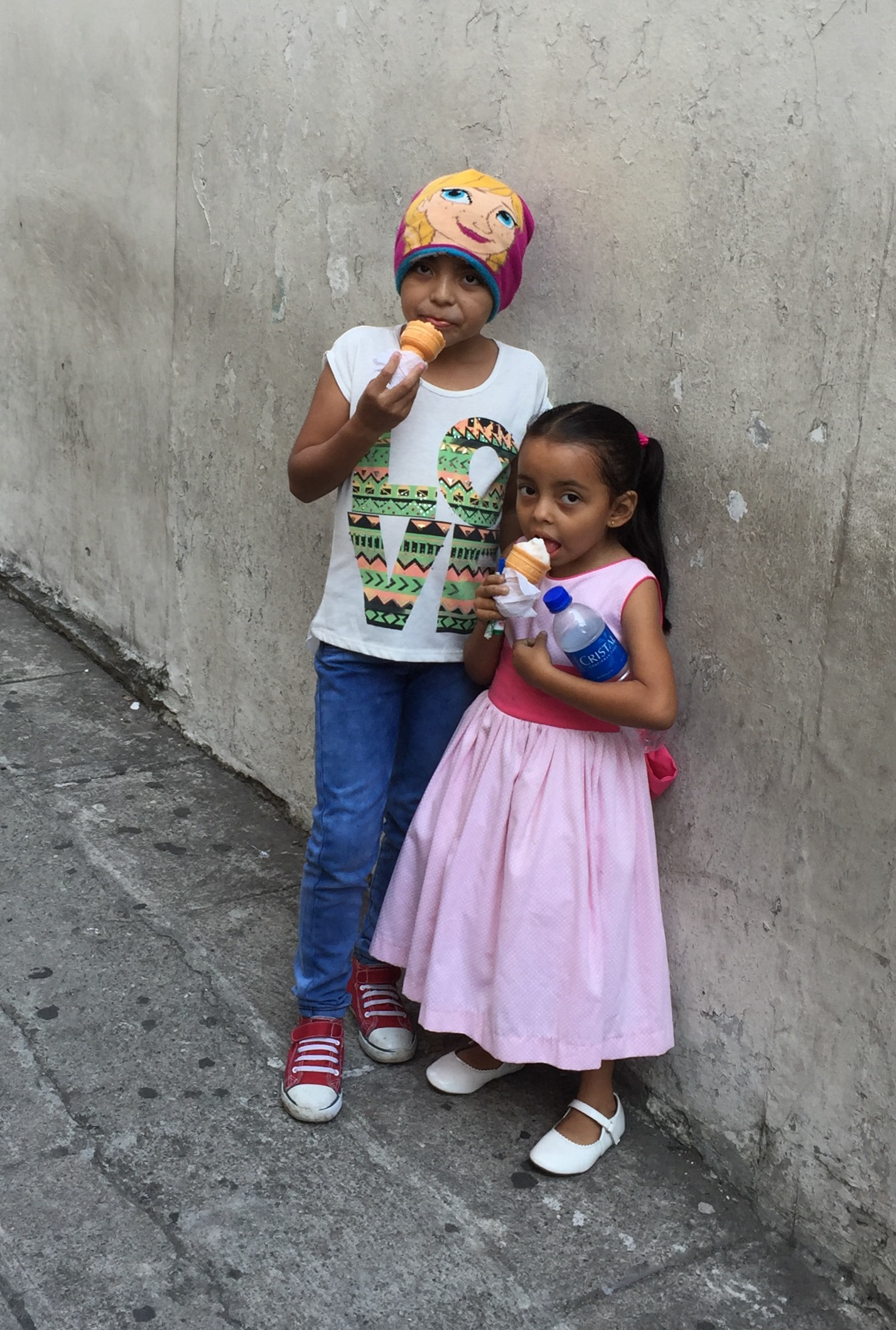 Children enjoying ice cream outside of San Salvador Cathedral.