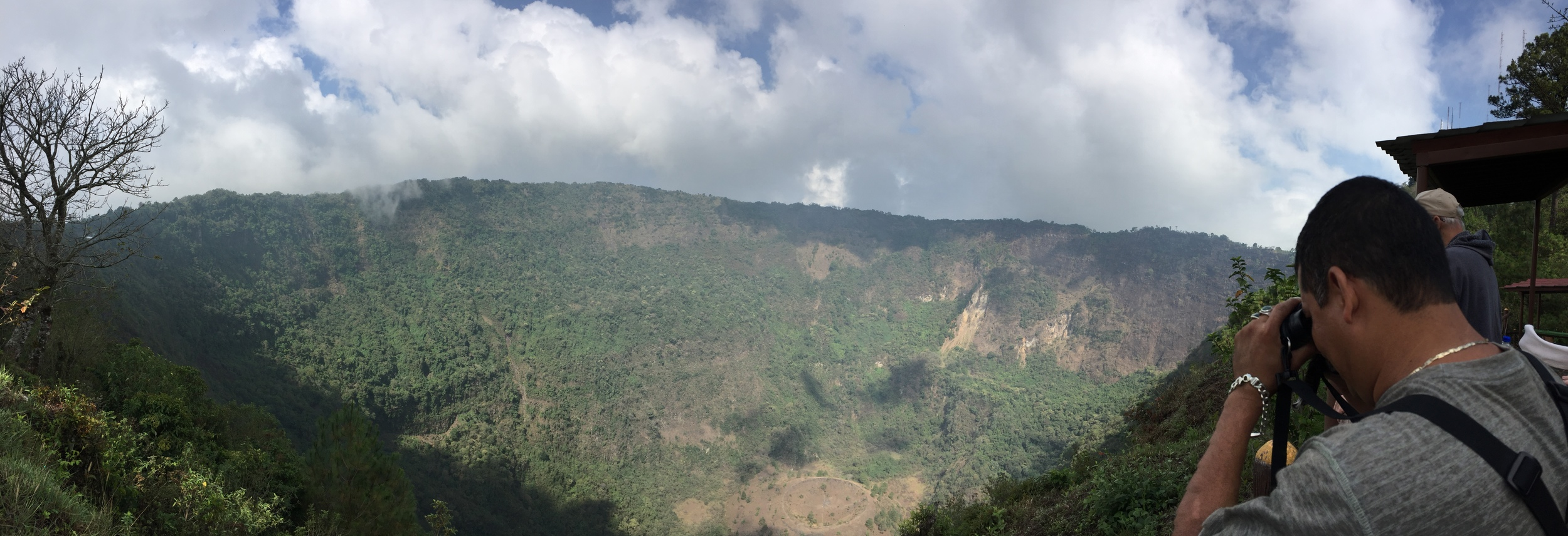 Looking out over the huge caldera of Quetzaltepec, an active volcano near San Salvador. This caldera known as El Boqueron (big mouth) used to hold a giant lake, which was blown away during the last eruption in 1917.