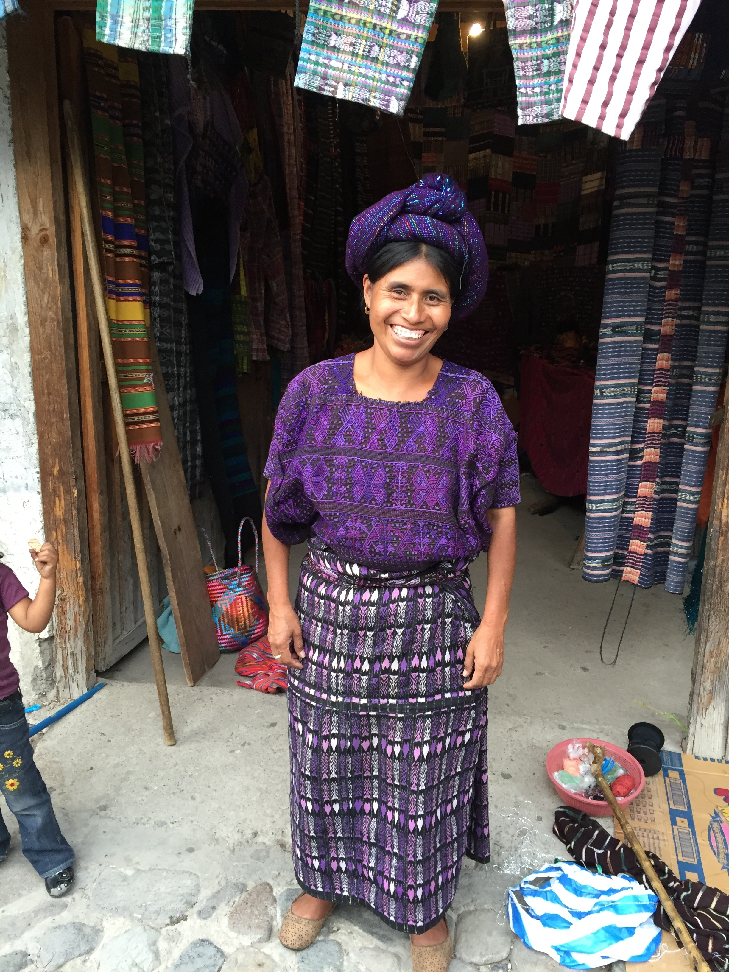 This woman in Pana sold beautiful old hand-woven textiles and hand embroidered huipils, like the one she is wearing. I bought one from her!