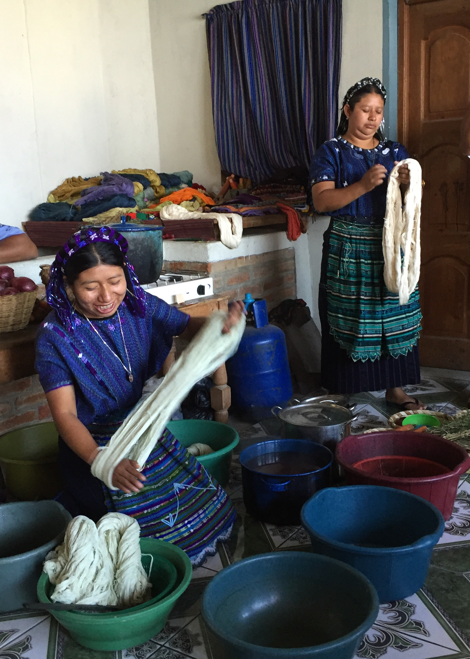 Women of the textile co-op at San Antonio Palopo, shown here using natural dyes to color the cotton before it is woven.