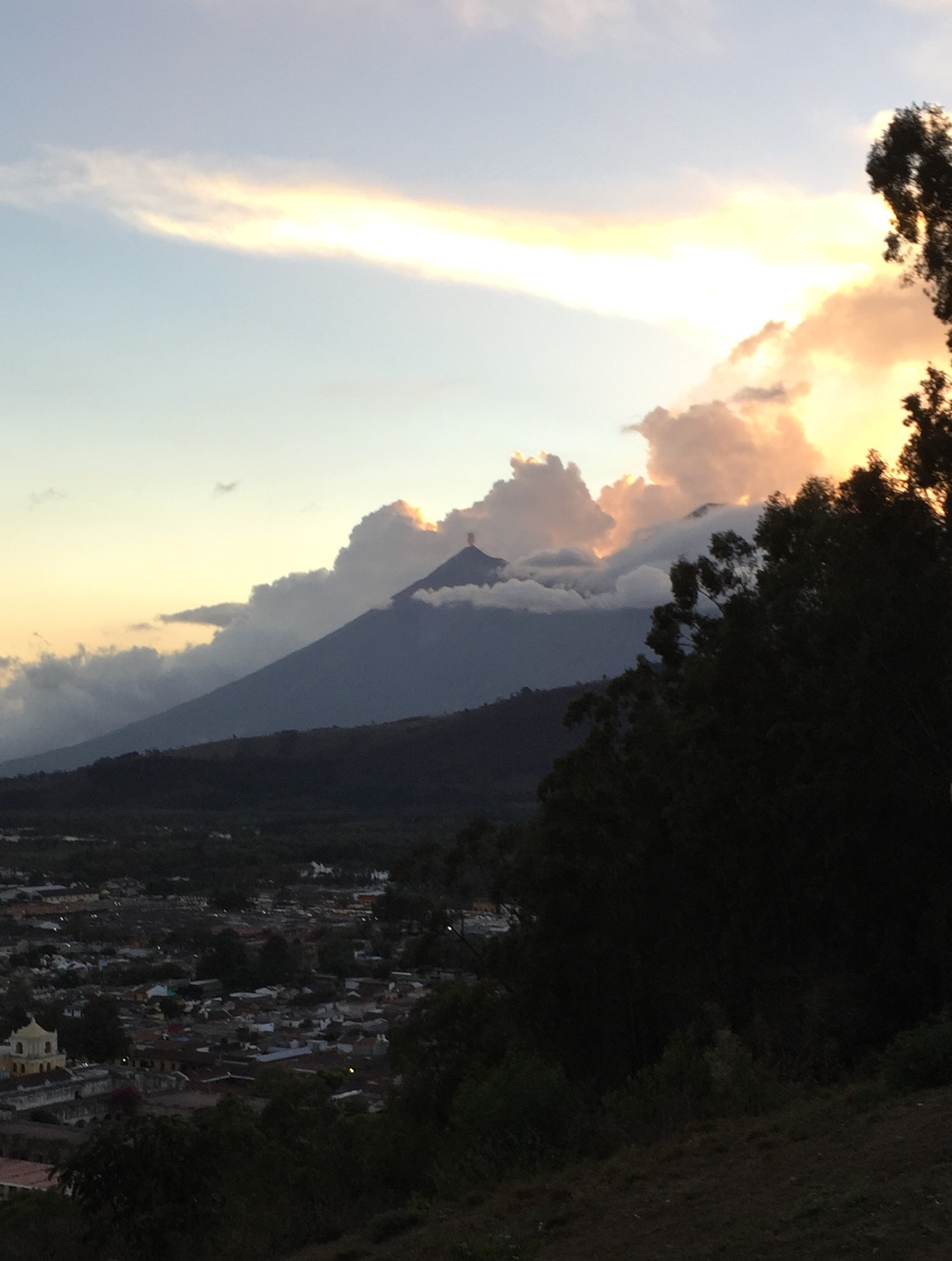 View from the Cerro de la Cruz above Antigua, as Volcán de Aguain erupts just after sunset.
