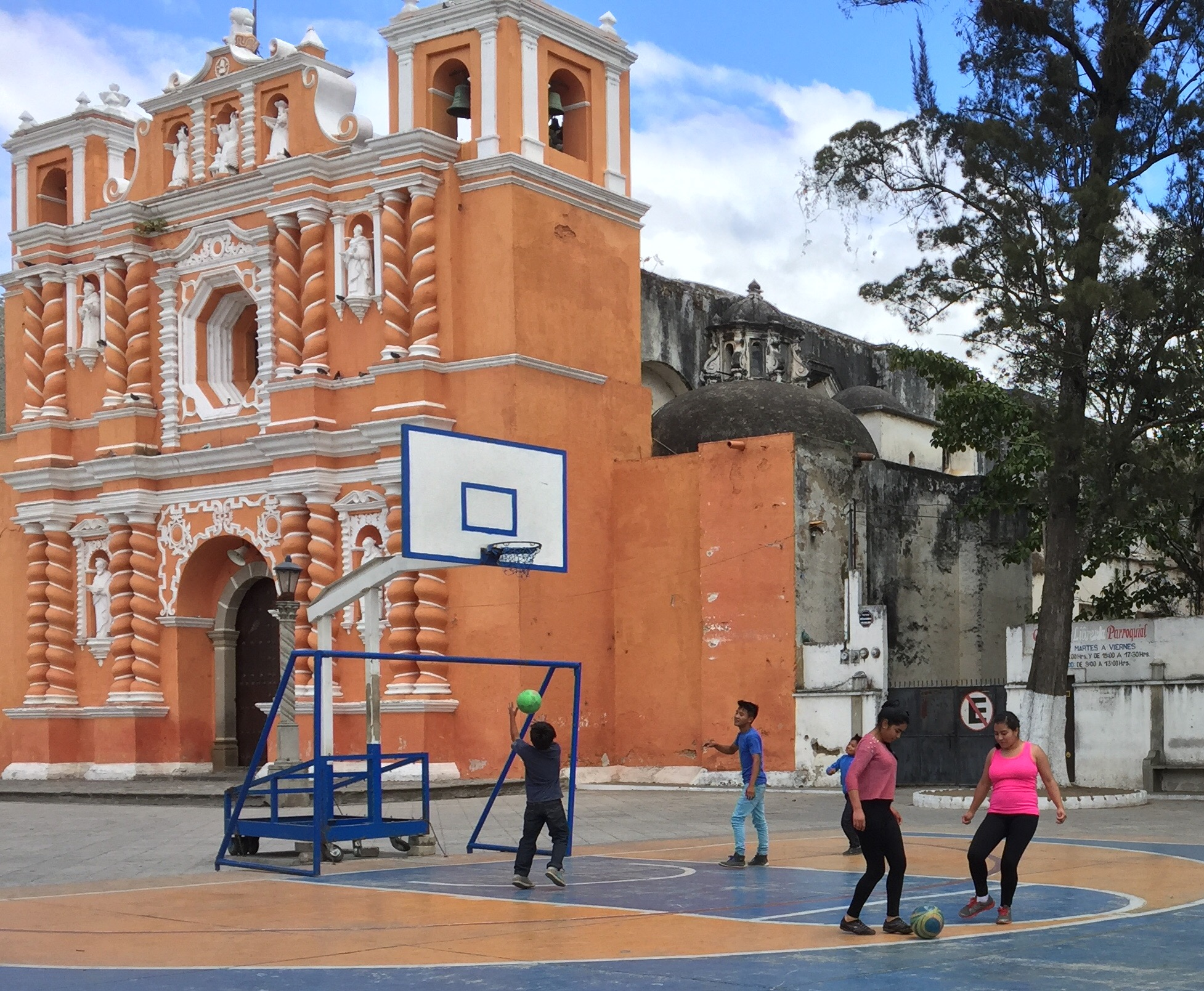 Kids playing basketball in front of the old convent in Antigua, Guatemala.