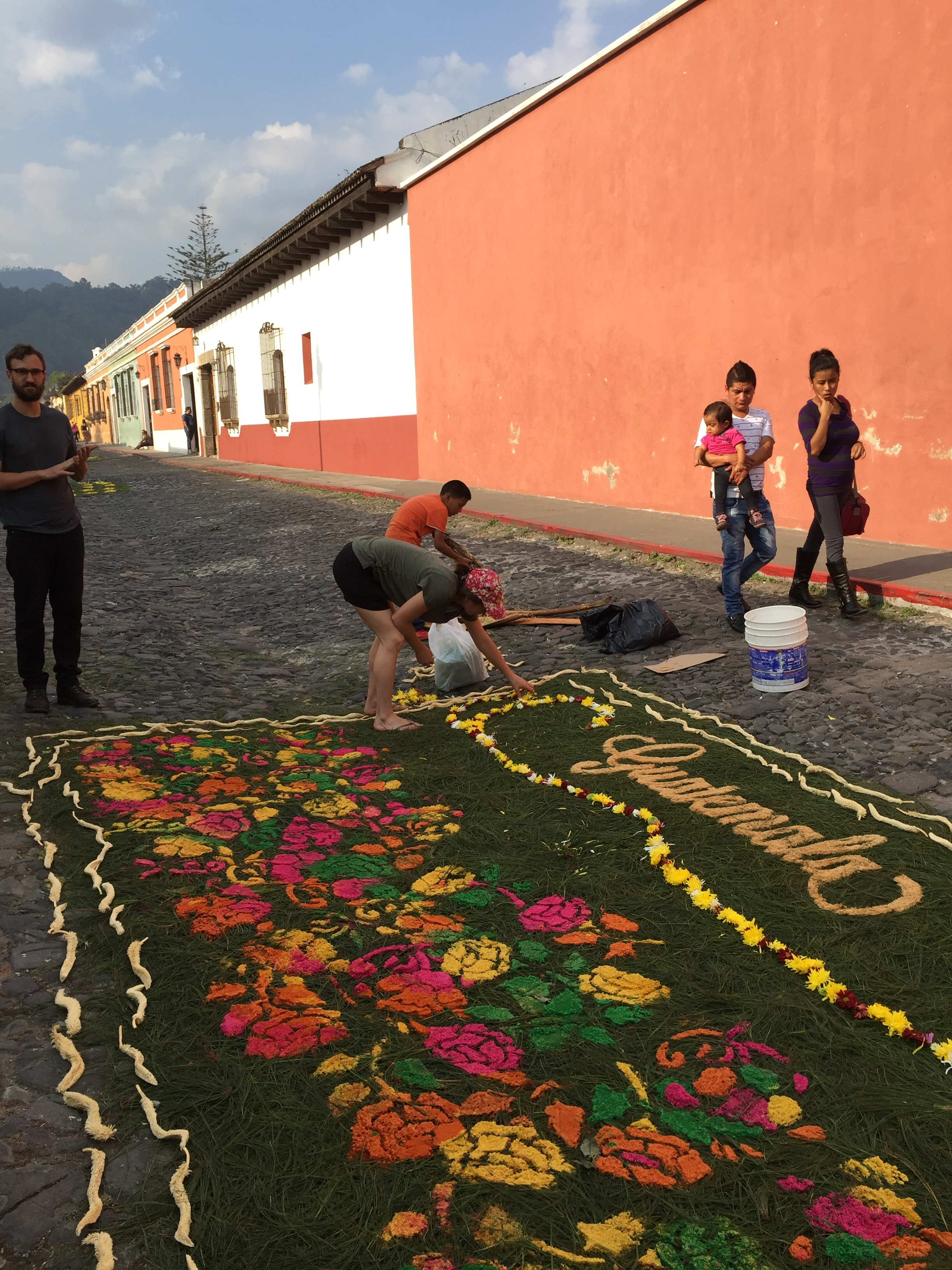 Locals join tourists in creating traditional sawdust carpets, which cover the sstreets of Antigua during the week before Easter.