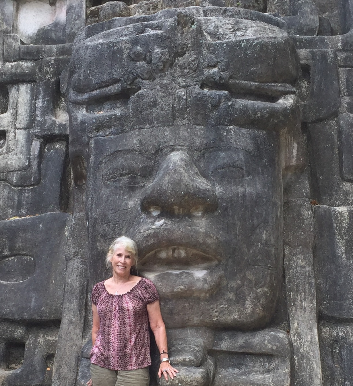 That's me in front of a massive stone carving at Laminai in Belize. Only a small fraction of the buildings of this site have been excavated.