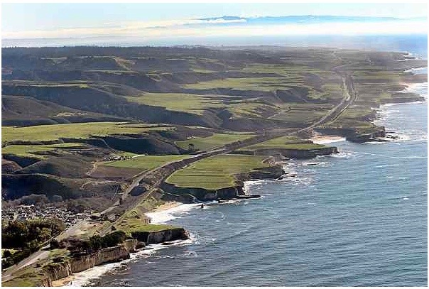 Looking down the coast from Davenport, at lower left, the Cotoni-Coast Dairies National Monument comprises most of the visible land from Highway 1 leading into the hills. (Flight courtesy of LightHawk). (Dan Coyro — Santa Cruz Sentinel)